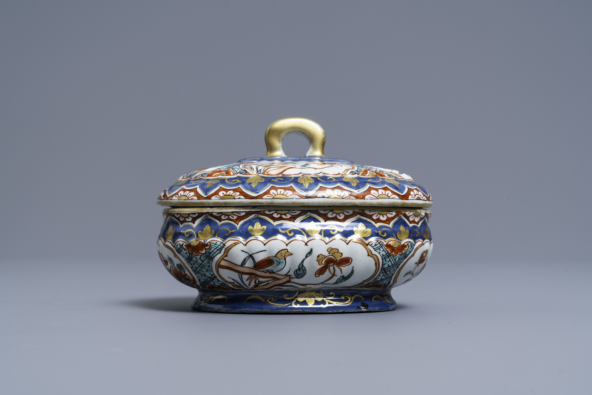 A polychrome and gilded Dutch Delft spice box and cover, early 18th C. - Image 4 of 7