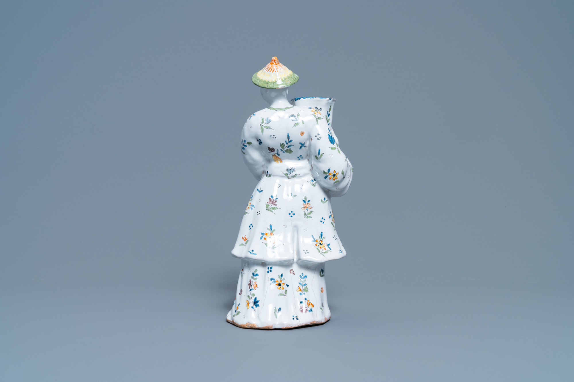 A polychrome French faience candle holder in the shape of a Chinaman, Lille, 18th C. - Image 4 of 7