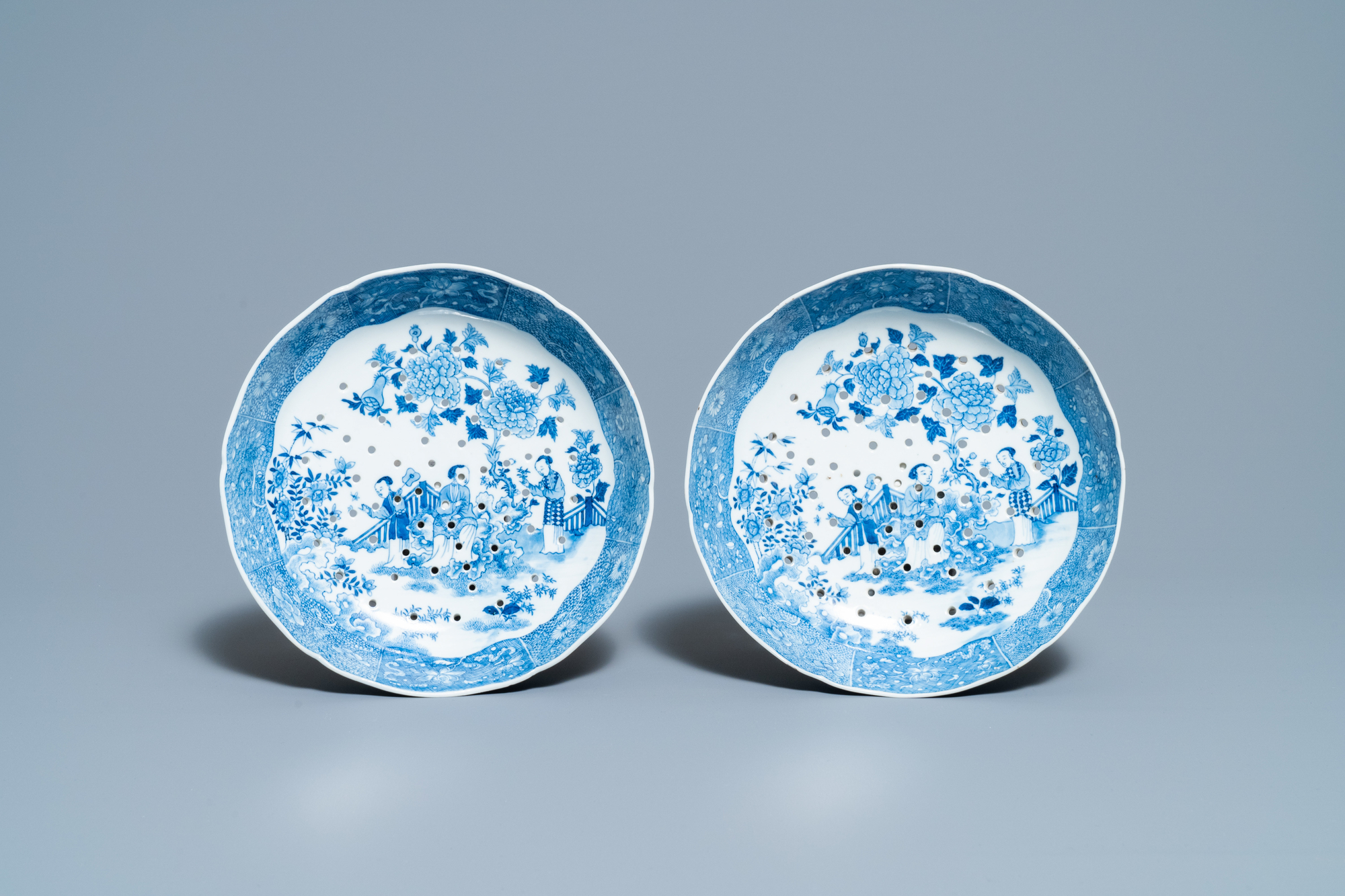 A pair of Chinese blue and white strainer dishes with ladies in a garden, Qianlong - Image 2 of 4