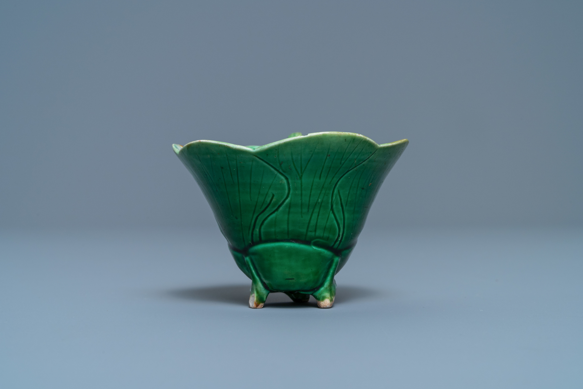 A Chinese 'egg and spinach'-glazed lotus cup and saucer with applied design, Kangxi - Image 7 of 9