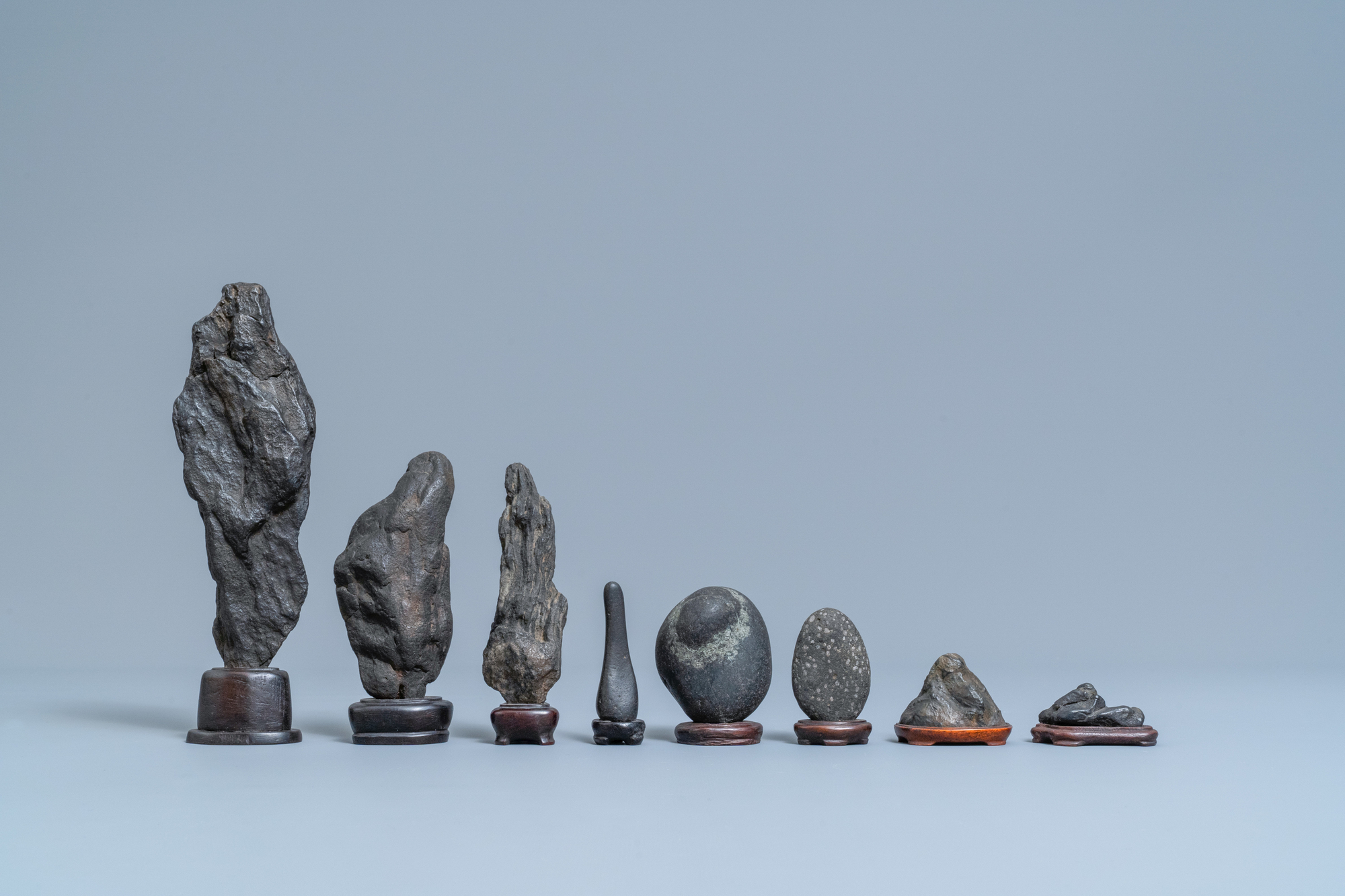 Eight Chinese scholar's rocks on wooden stands, 19/20th C. - Image 2 of 7