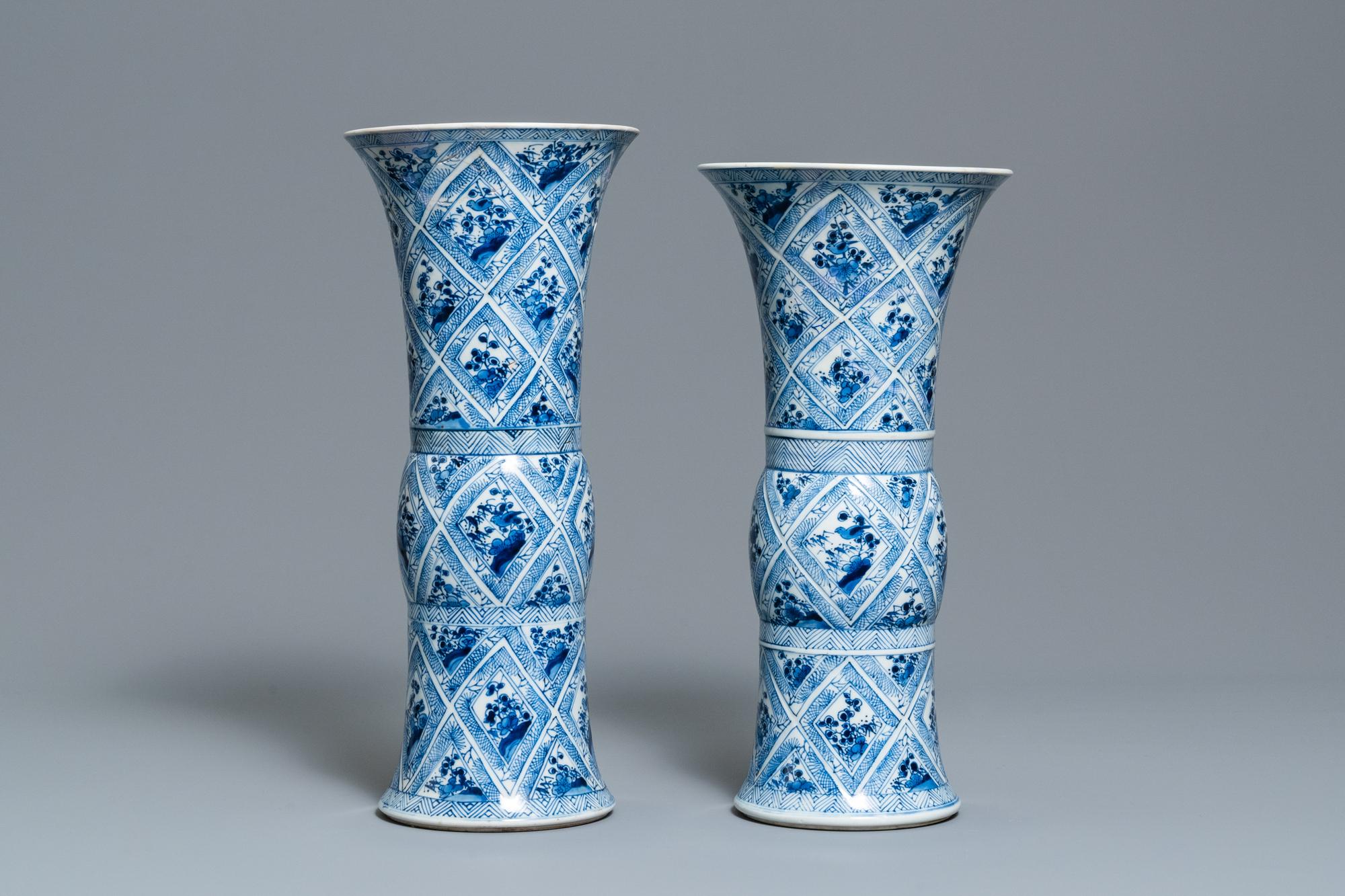 A large Chinese blue and white five-piece garniture with floral and landscape panels, Kangxi - Image 12 of 66