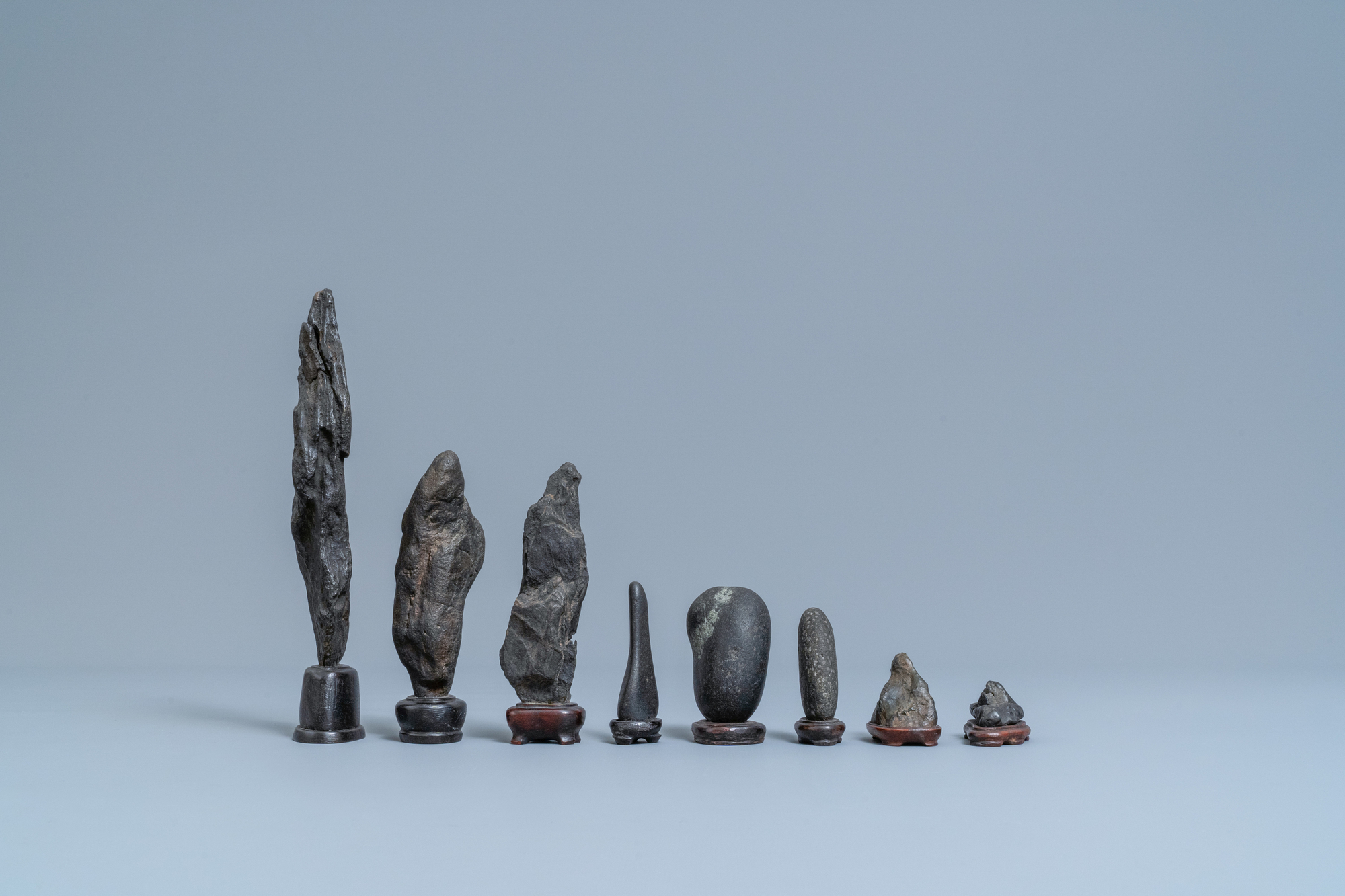 Eight Chinese scholar's rocks on wooden stands, 19/20th C. - Image 5 of 7