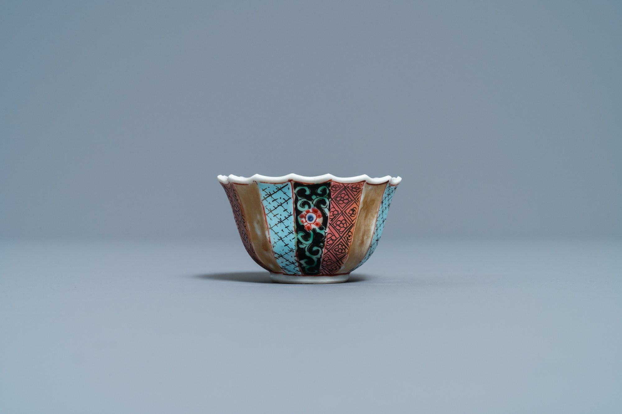 A lobed Chinese famille rose 'fishermen' cup and saucer, Yongzheng - Image 5 of 9