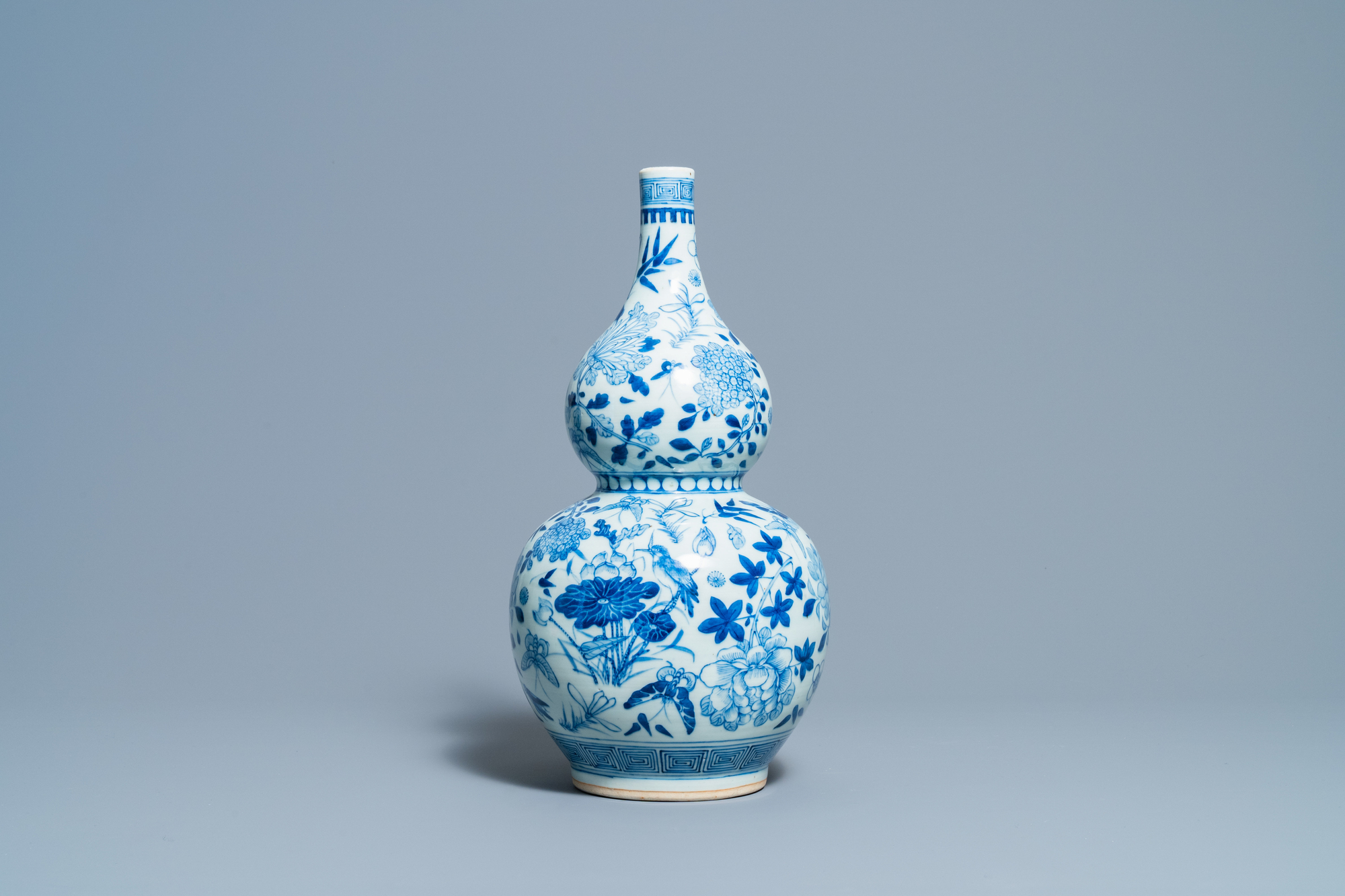 A Chinese blue and white double gourd vase, 19th C.