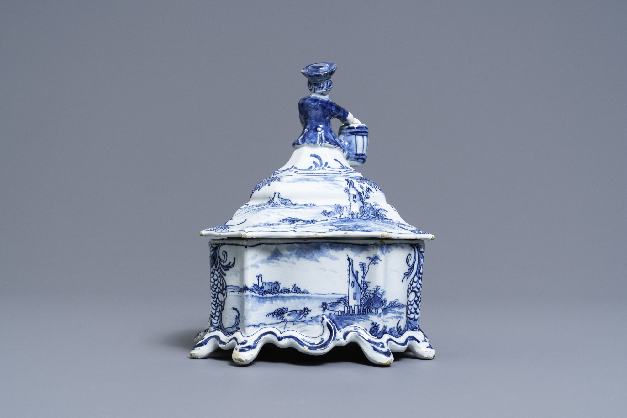 A Dutch Delft blue and white tobacco box and cover with a boy near a barrel, 18th C. - Image 3 of 7