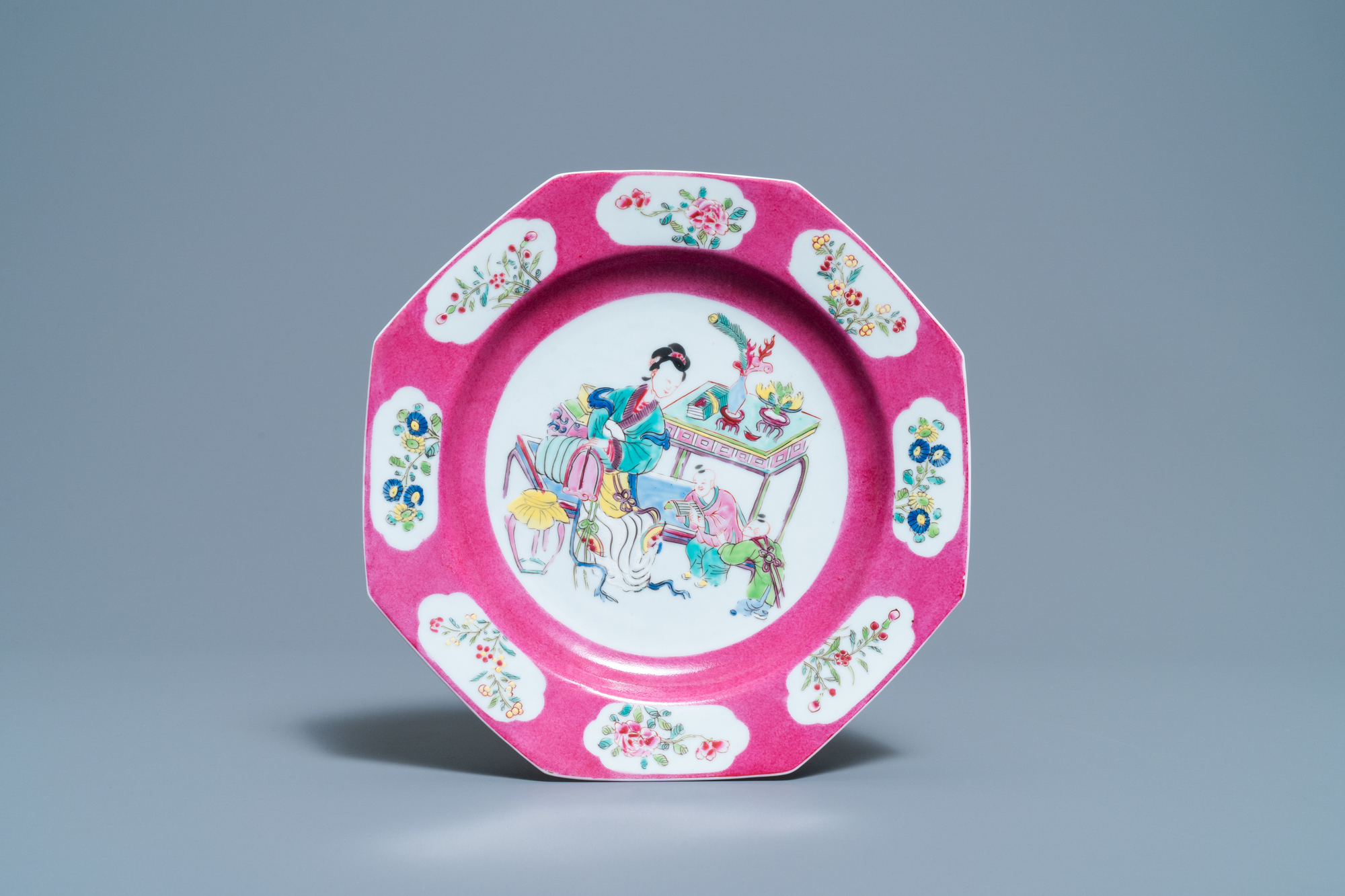 A Chinese octagonal famille rose 'ruby border' plate, Yongzheng