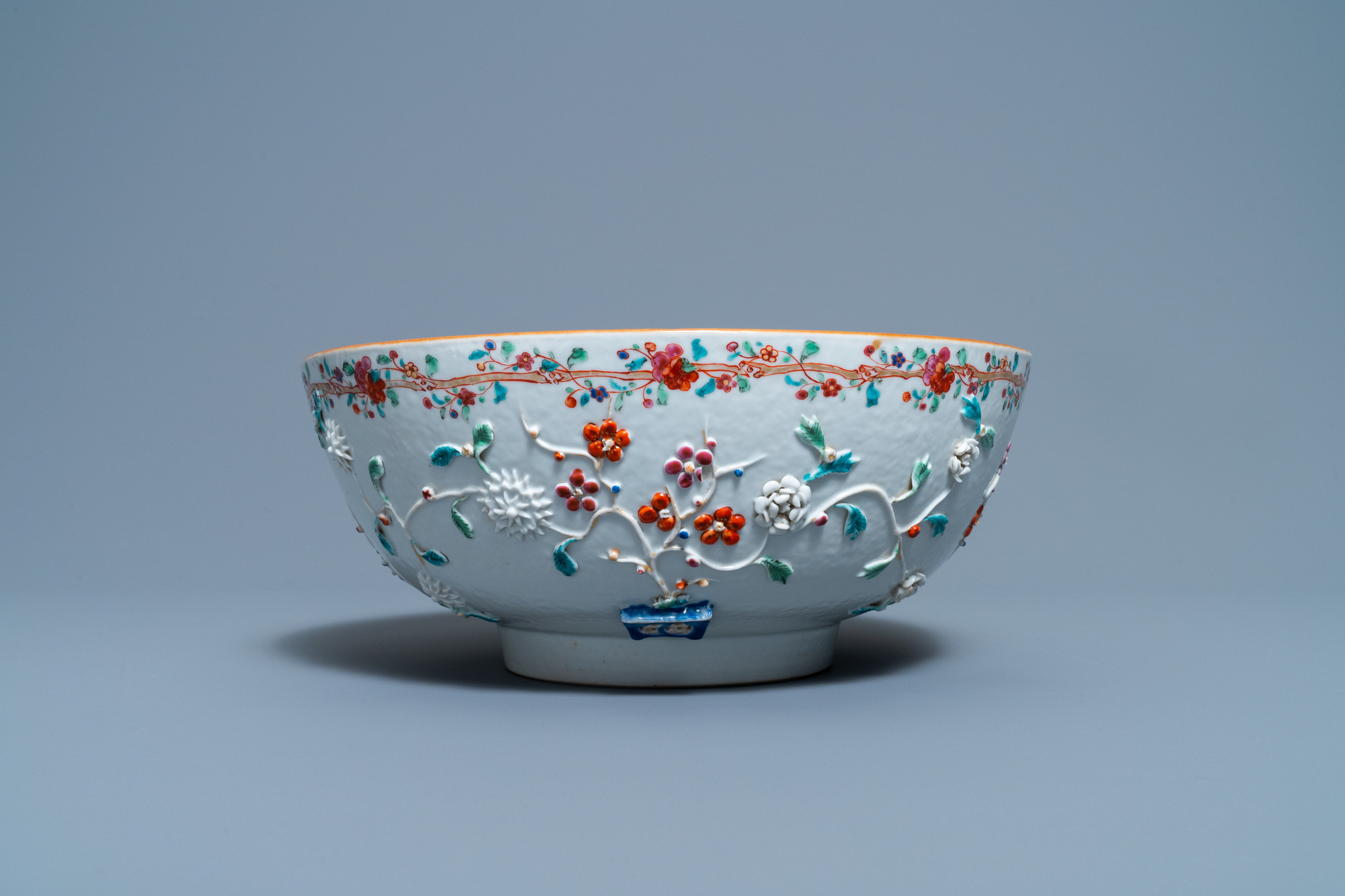 A Chinese famille rose relief-decorated floral bowl, Yongzheng/Qianlong - Image 2 of 7