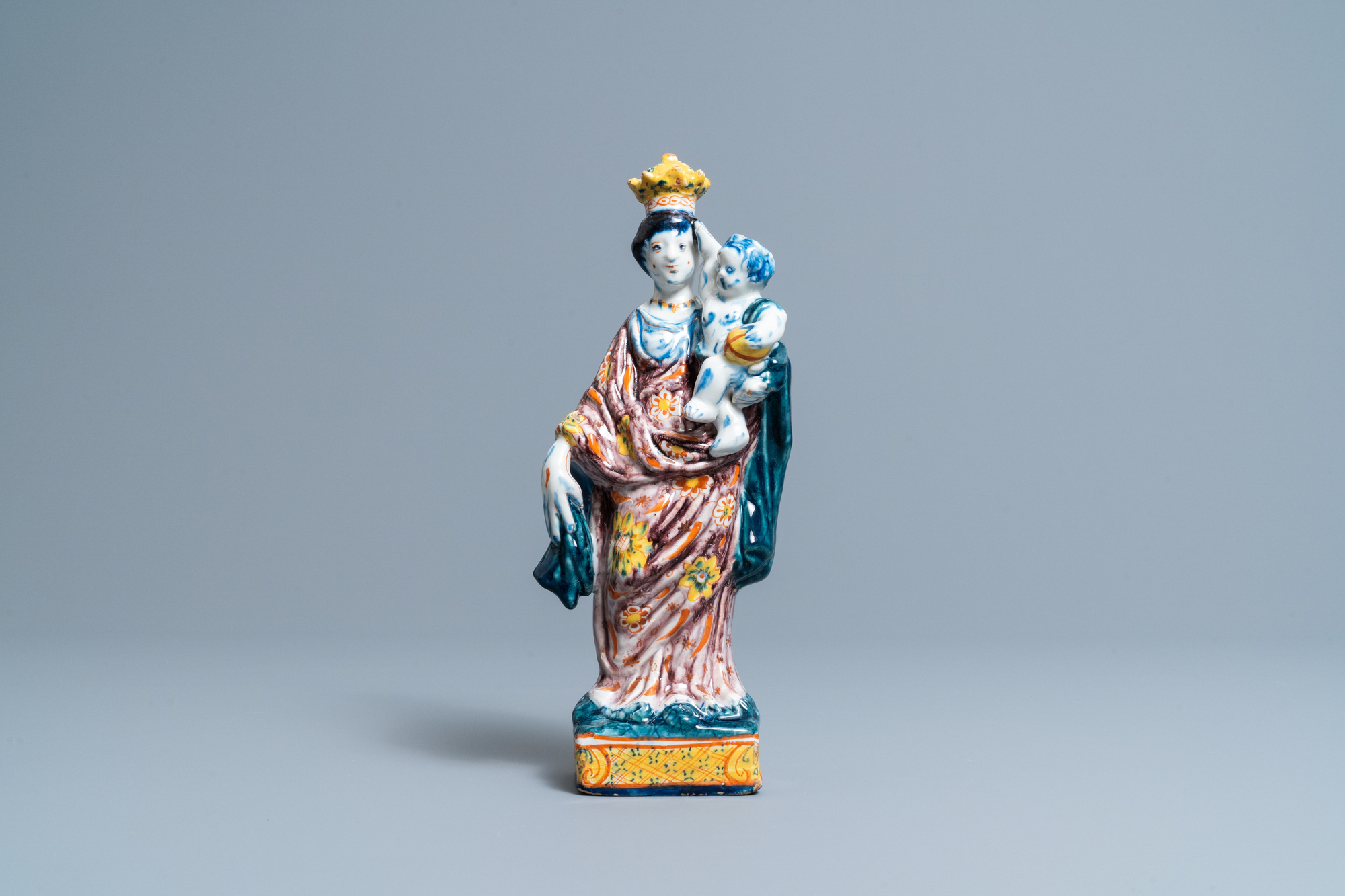 A polychrome Dutch Delft figure of the Madonna with child, 18th C. - Image 2 of 7