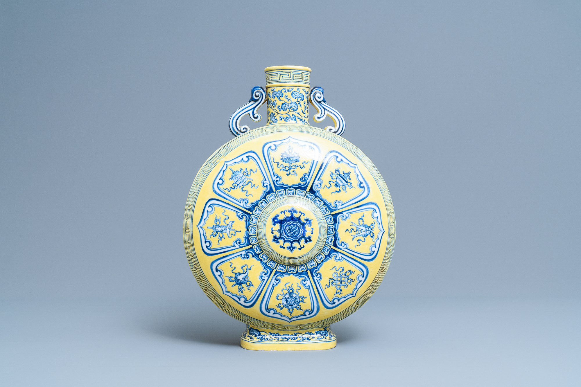 A Chinese yellow-ground blue and white 'Bajixiang' moonflask vase, Yongzheng mark, 19/20th C. - Image 3 of 20
