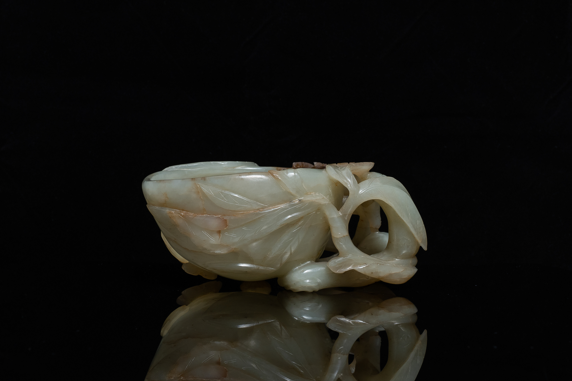 A Chinese mottled celadon and brown jade peach-form brush washer, Qing - Image 2 of 12