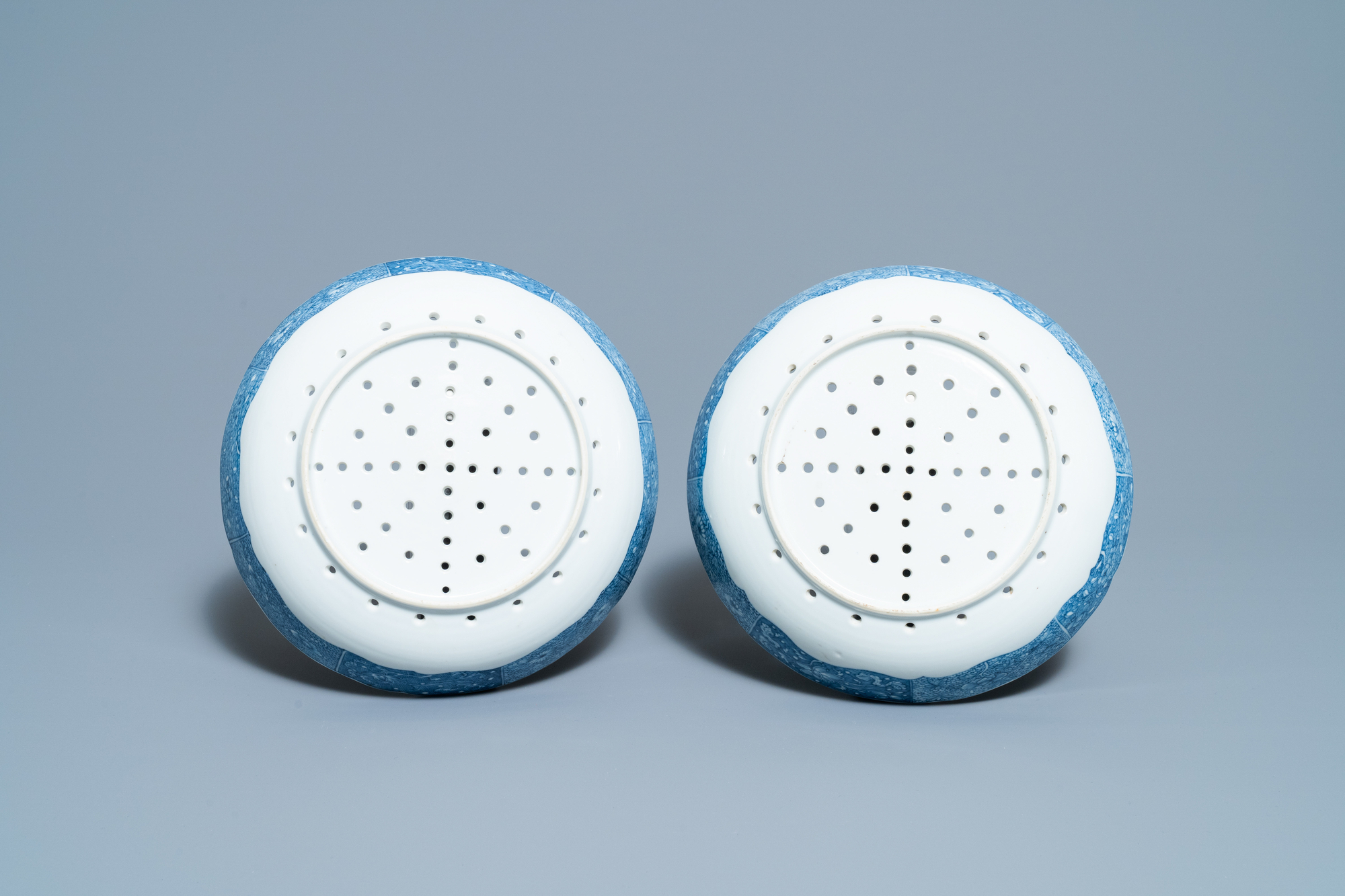 A pair of Chinese blue and white strainer dishes with ladies in a garden, Qianlong - Image 3 of 4