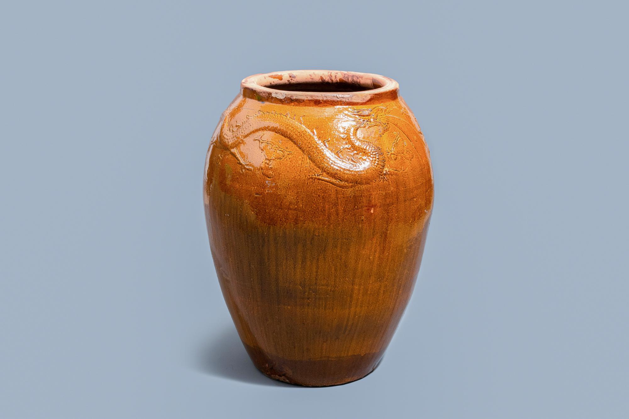 A massive Chinese brown-glazed 'dragon and phoenix' martaban jar, Qing