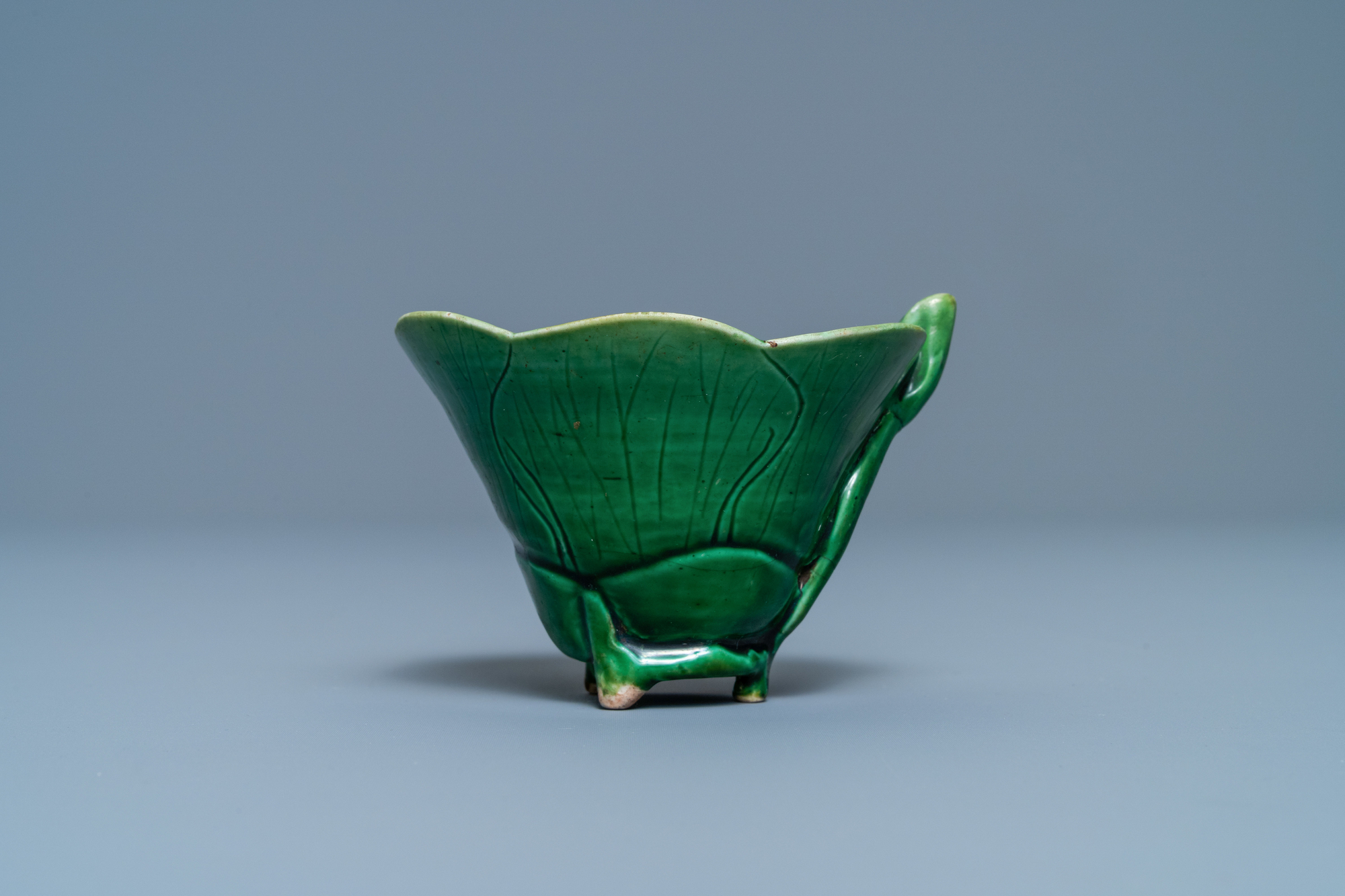 A Chinese 'egg and spinach'-glazed lotus cup and saucer with applied design, Kangxi - Image 6 of 9