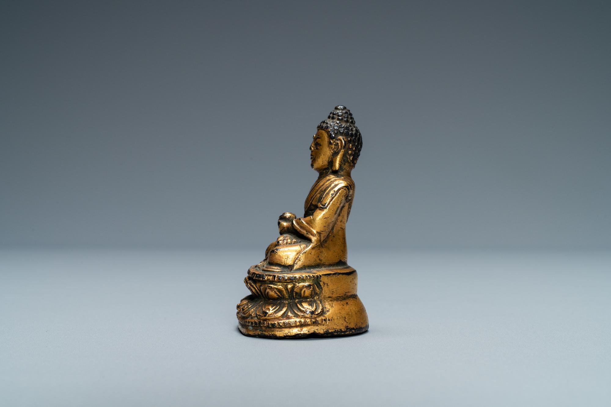 A Sino-Tibetan gilt bronze figure of Buddha, Ming - Image 2 of 7