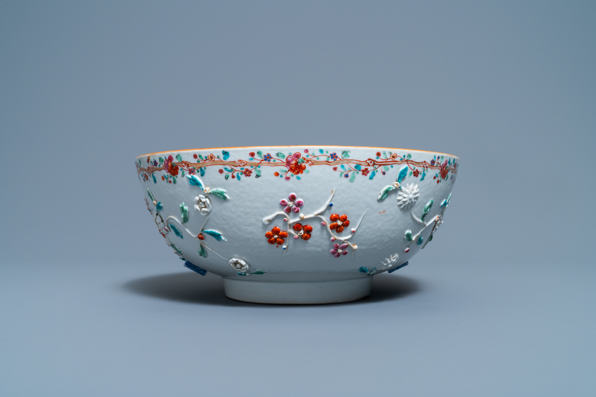 A Chinese famille rose relief-decorated floral bowl, Yongzheng/Qianlong - Image 3 of 7