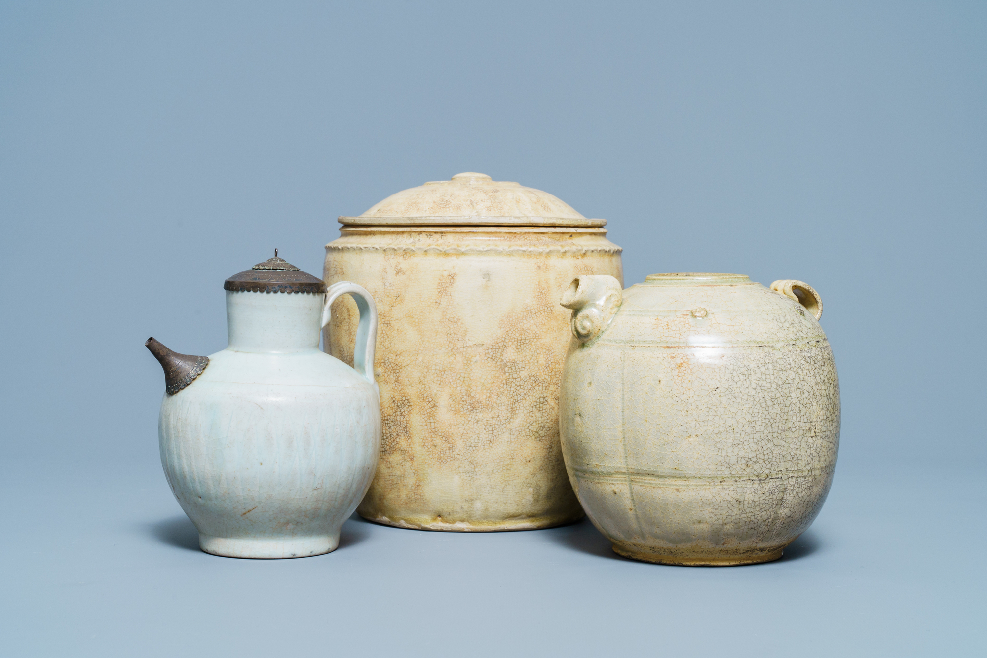 A Chinese celadon-glazed 'Jue' ewer, a qingbai-glazed wine ewer and a storage vessel, Song/Yuan