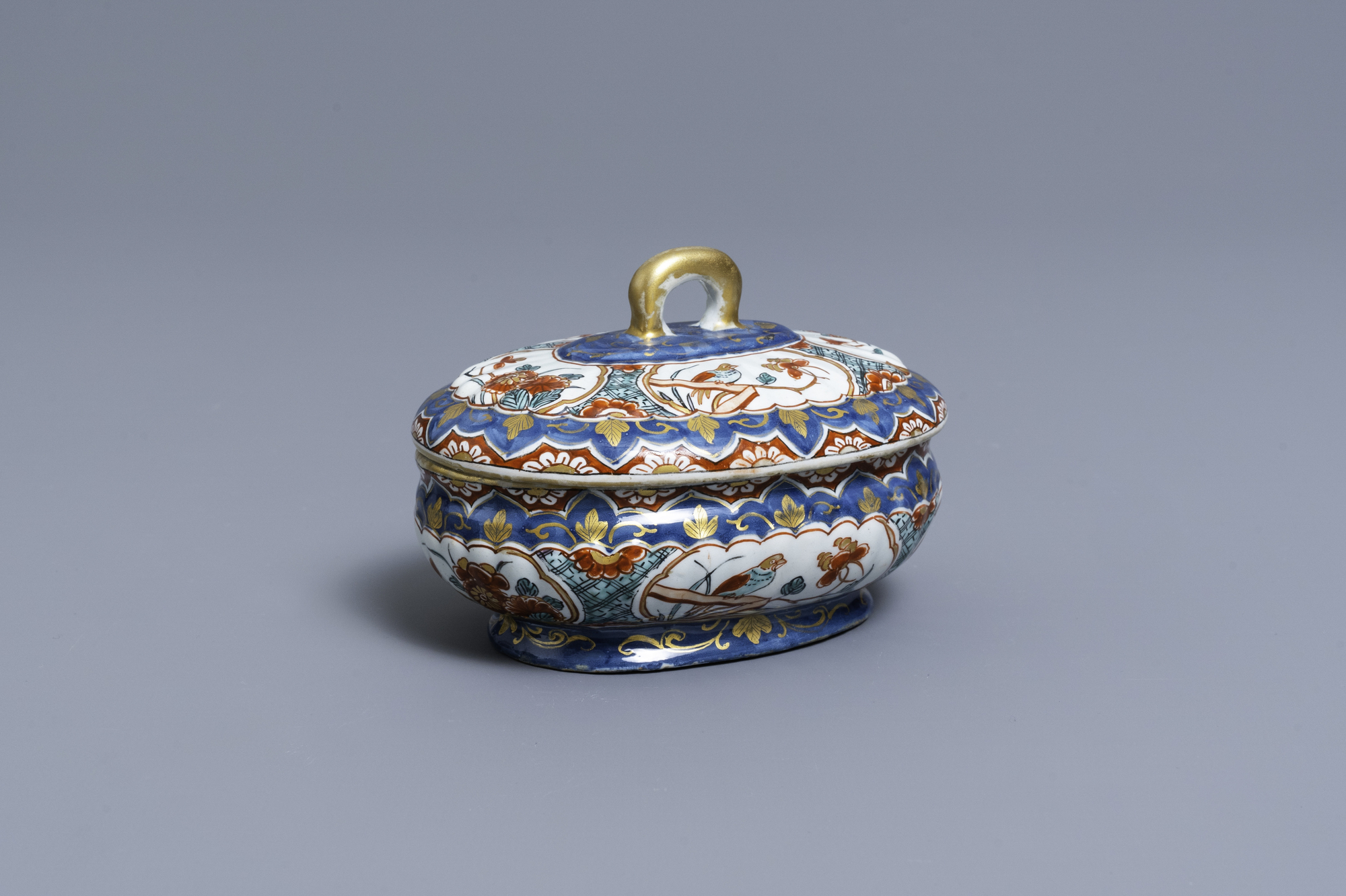 A polychrome and gilded Dutch Delft spice box and cover, early 18th C.