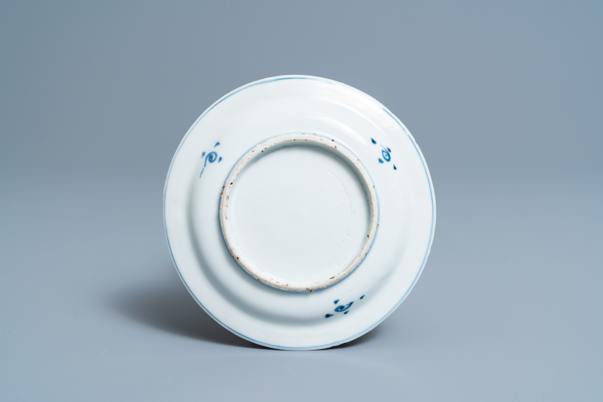 A Chinese blue, white and copper-red 'fish' plate, Wanli - Image 2 of 2