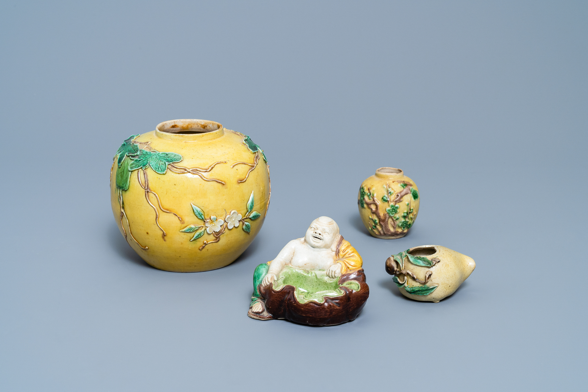 Two Chinese biscuit jars, a Buddha figure and a brushwasher, 19/20th C.