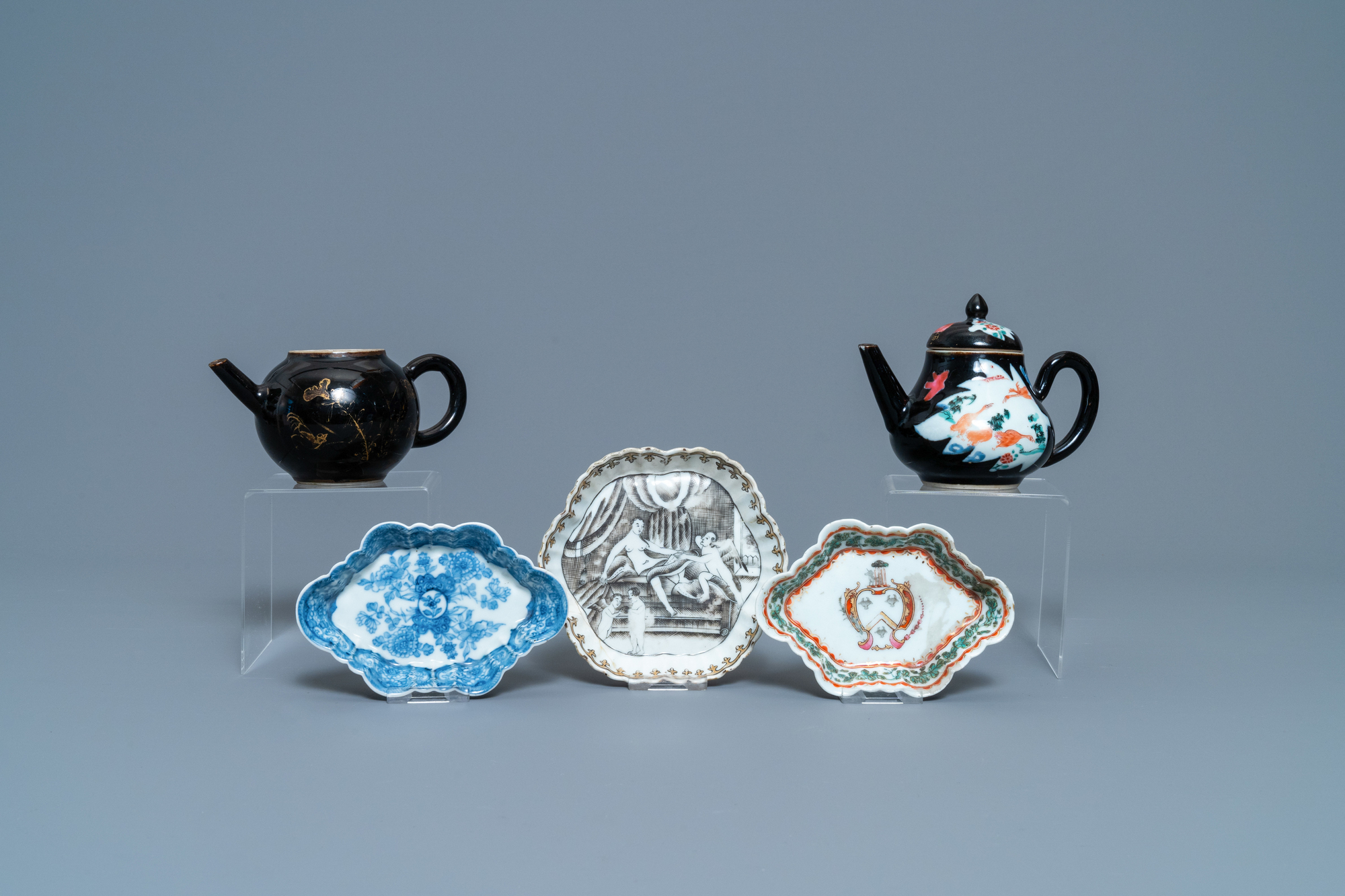 Two Chinese famille noire teapots, a pattipan and two spoon trays, Yongzheng/Qianlong
