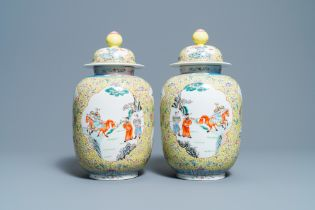 A pair of Chinese famille rose yellow-ground vases and covers, Guangxu mark, Republic