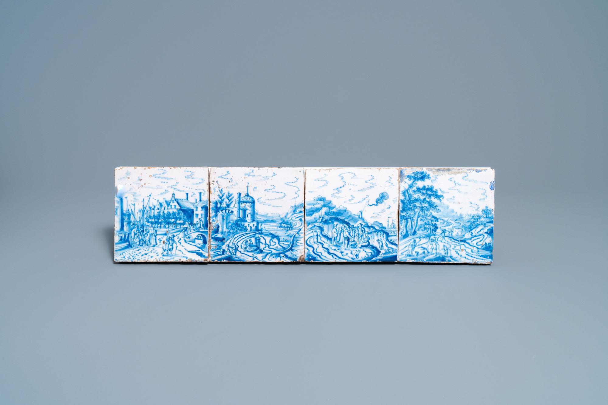 Four fine Dutch Delft blue and white 'open landscape' tiles, 18th C.