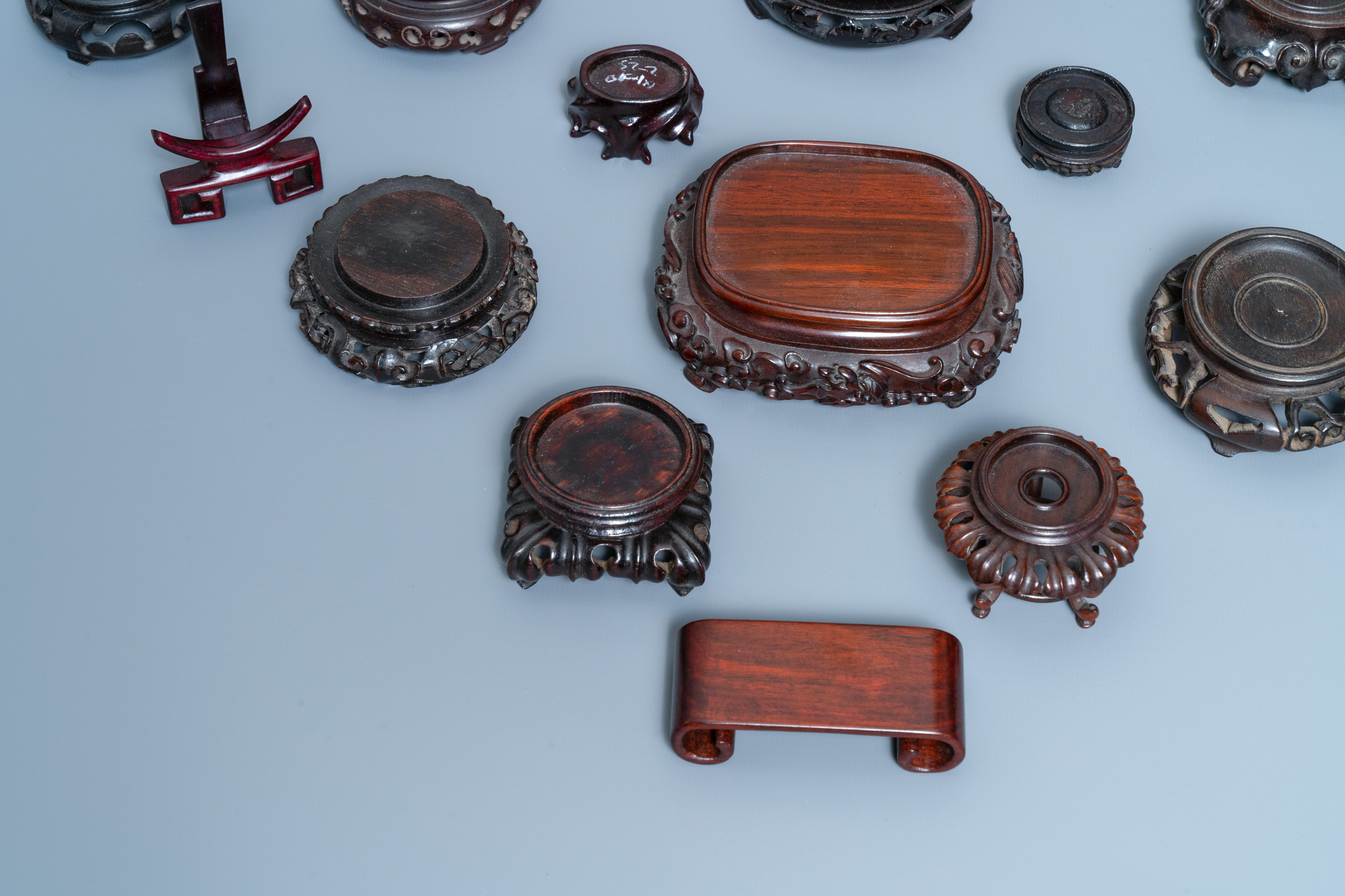 26 Chinese carved wooden stands, 19/20th C. - Image 5 of 12