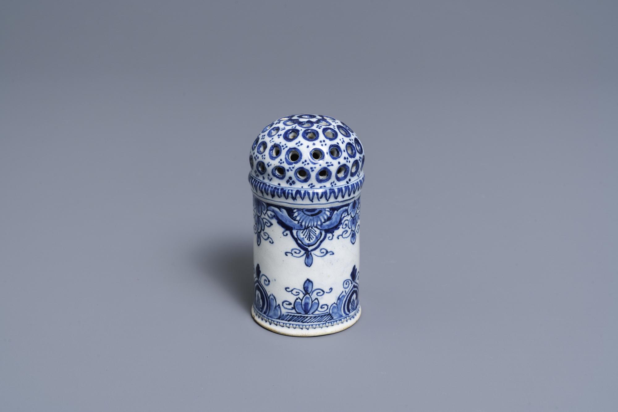 A Dutch Delft blue and white caster, 18th C.