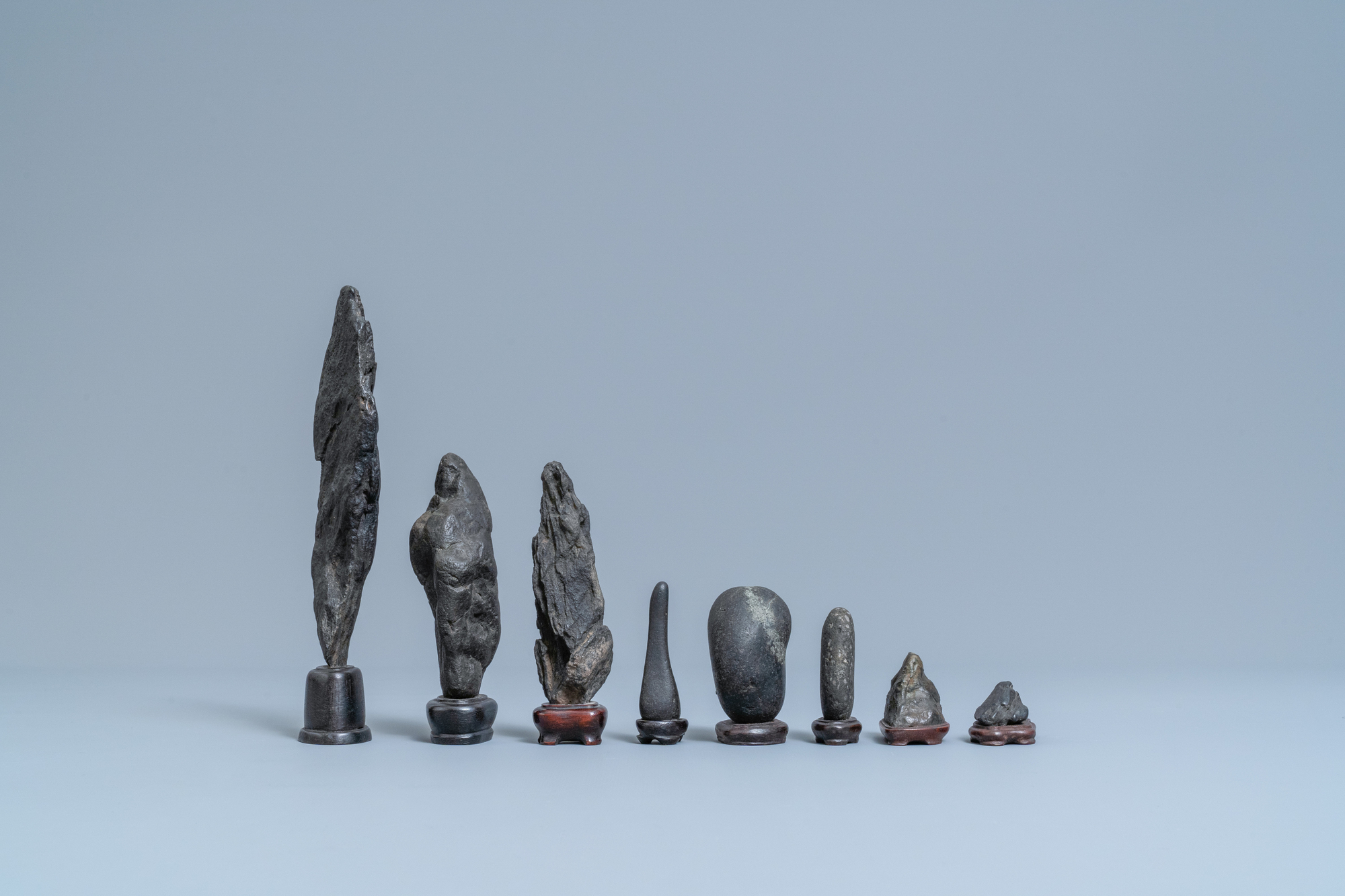 Eight Chinese scholar's rocks on wooden stands, 19/20th C. - Image 3 of 7