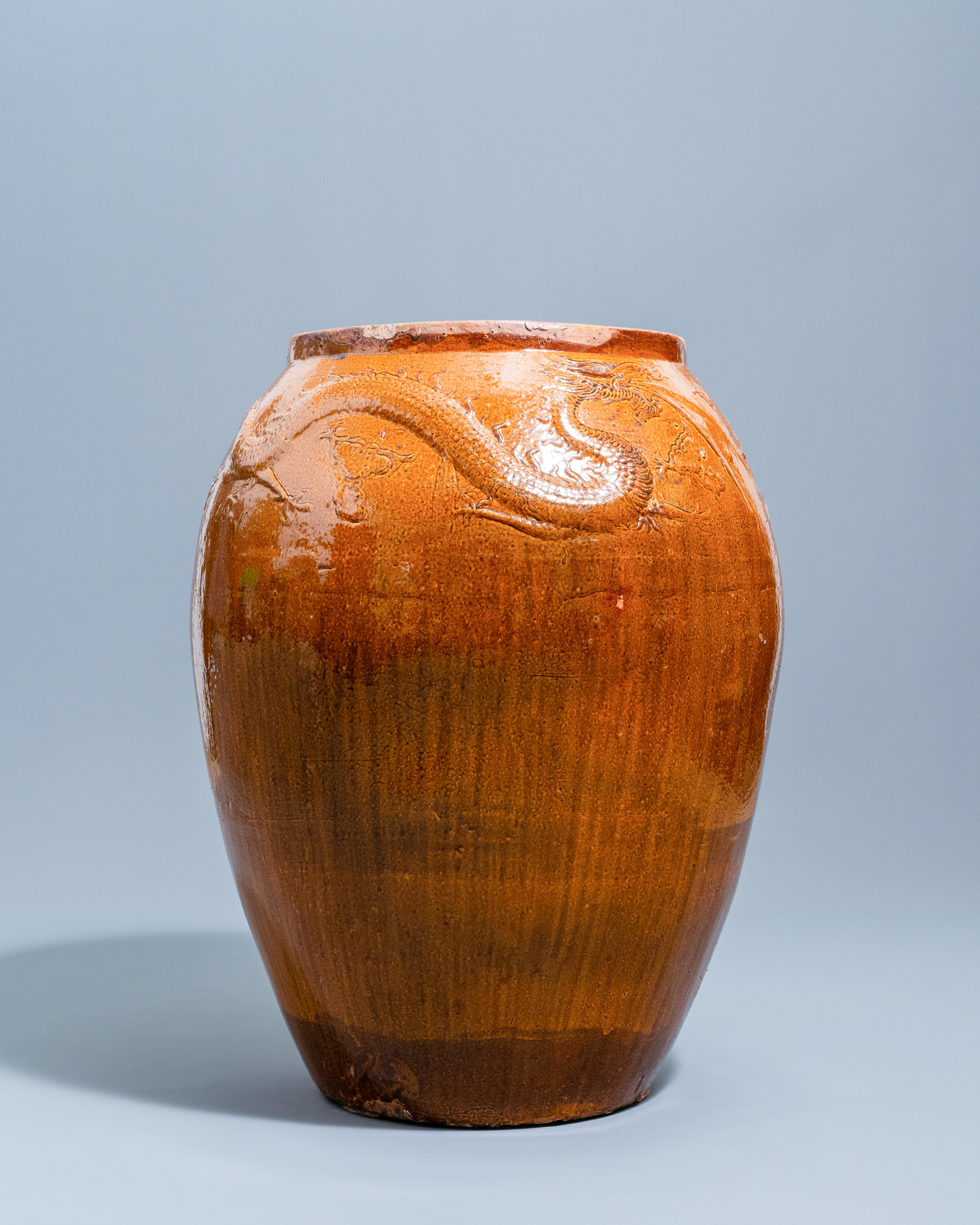 A massive Chinese brown-glazed 'dragon and phoenix' martaban jar, Qing - Image 2 of 7