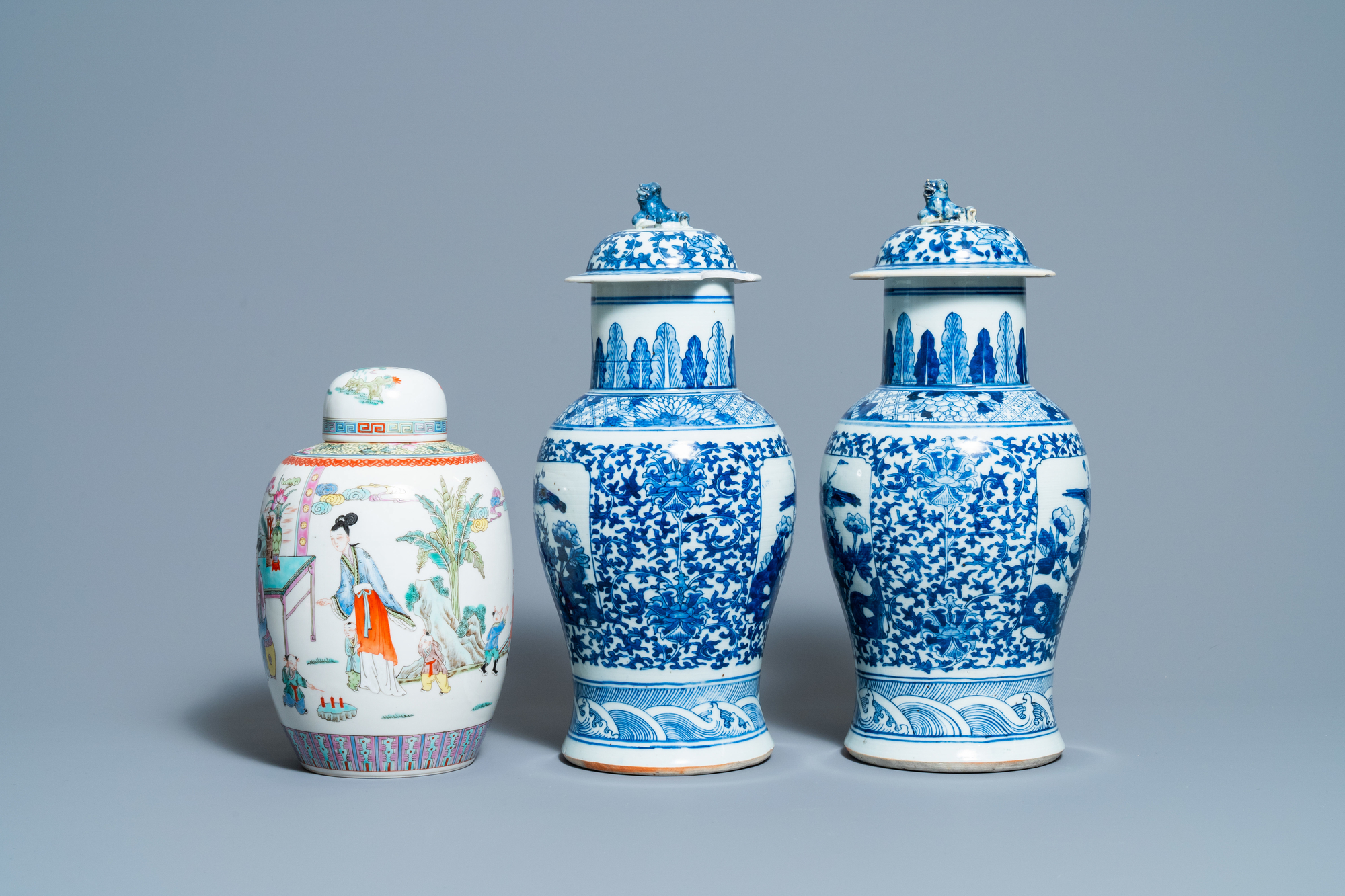 A pair of Chinese blue and white vases and a famille rose jar and cover, 19/20th C. - Image 3 of 9