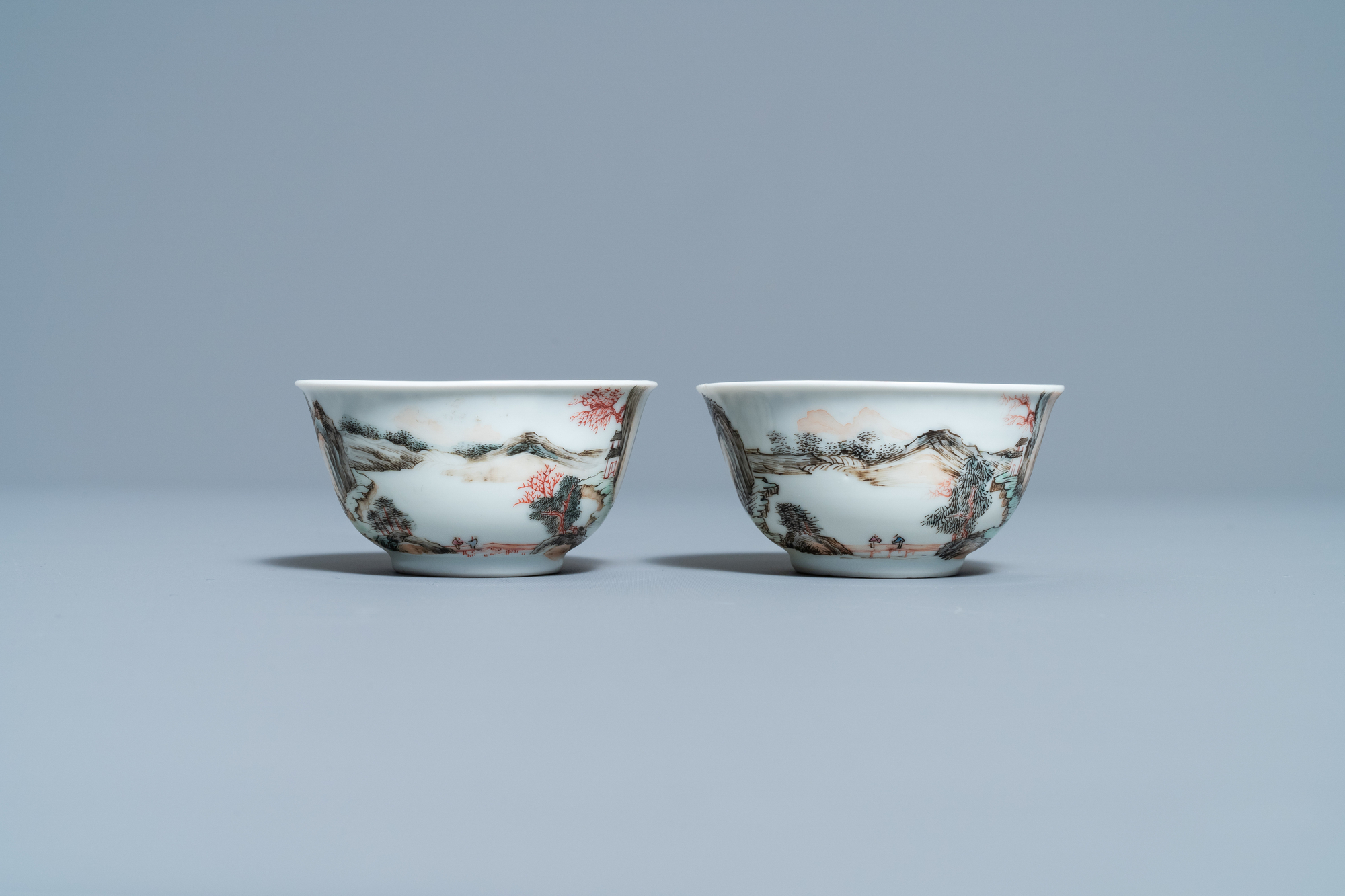 A fine Chinese 'landscape' teapot and a pair of cups and saucers, Yongzheng - Image 5 of 15