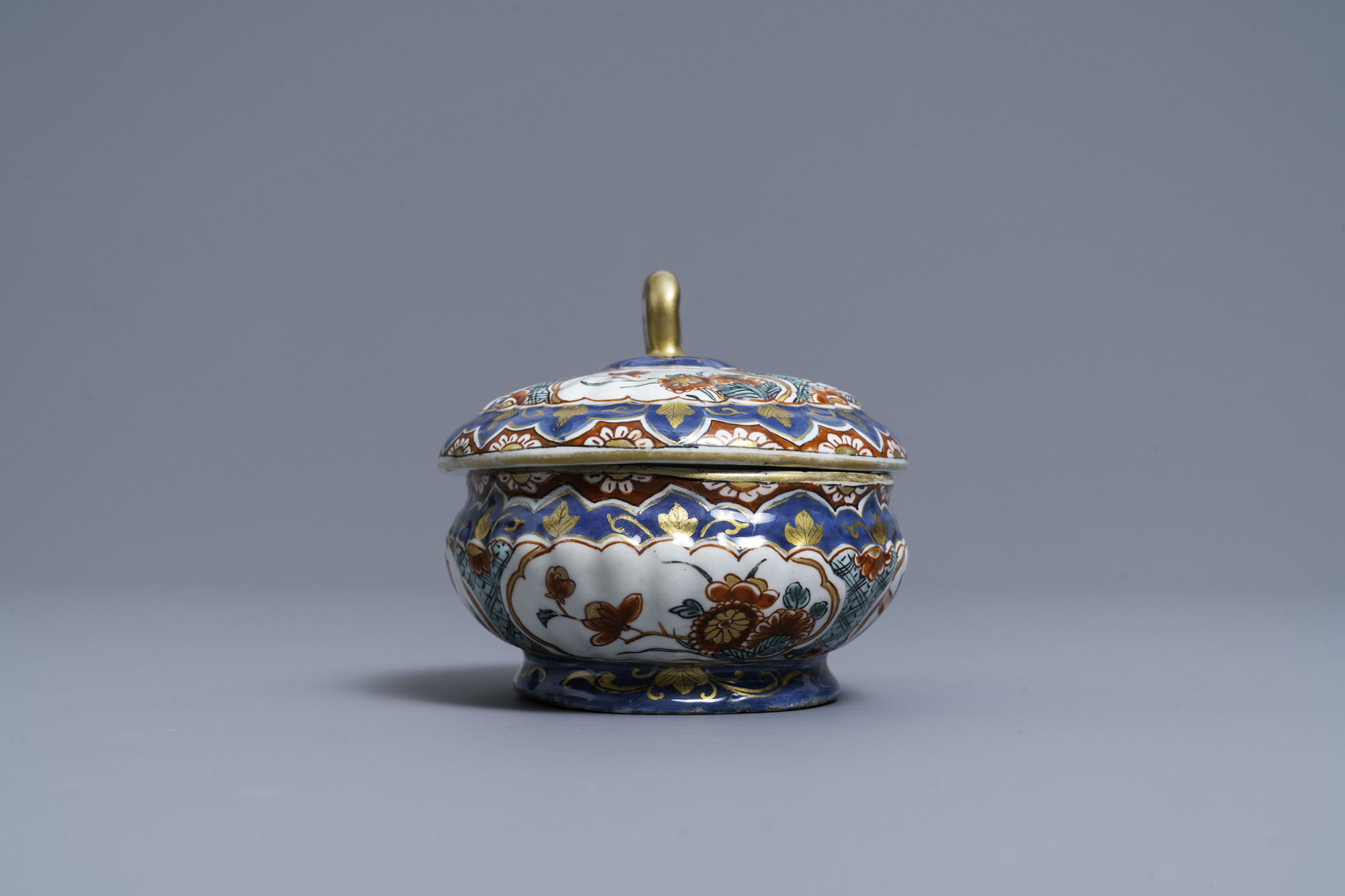 A polychrome and gilded Dutch Delft spice box and cover, early 18th C. - Image 5 of 7