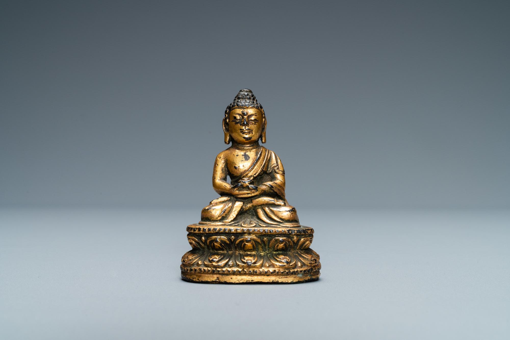 A Sino-Tibetan gilt bronze figure of Buddha, Ming