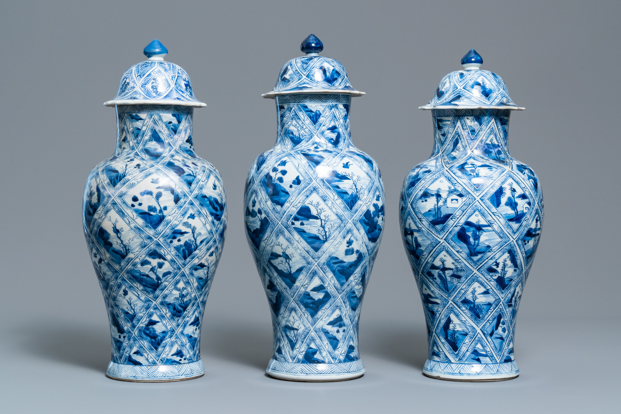A large Chinese blue and white five-piece garniture with floral and landscape panels, Kangxi - Image 3 of 66