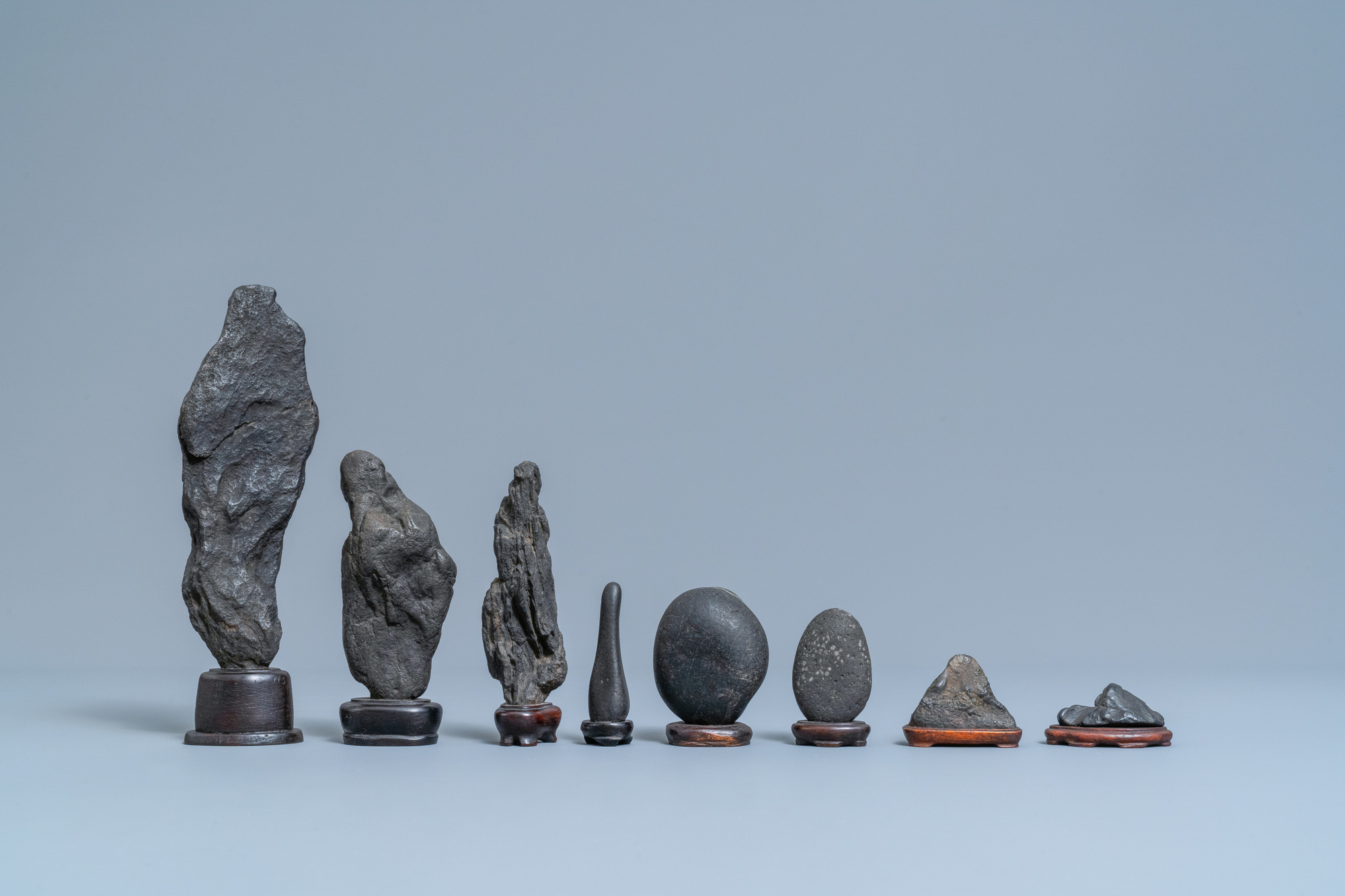 Eight Chinese scholar's rocks on wooden stands, 19/20th C. - Image 4 of 7