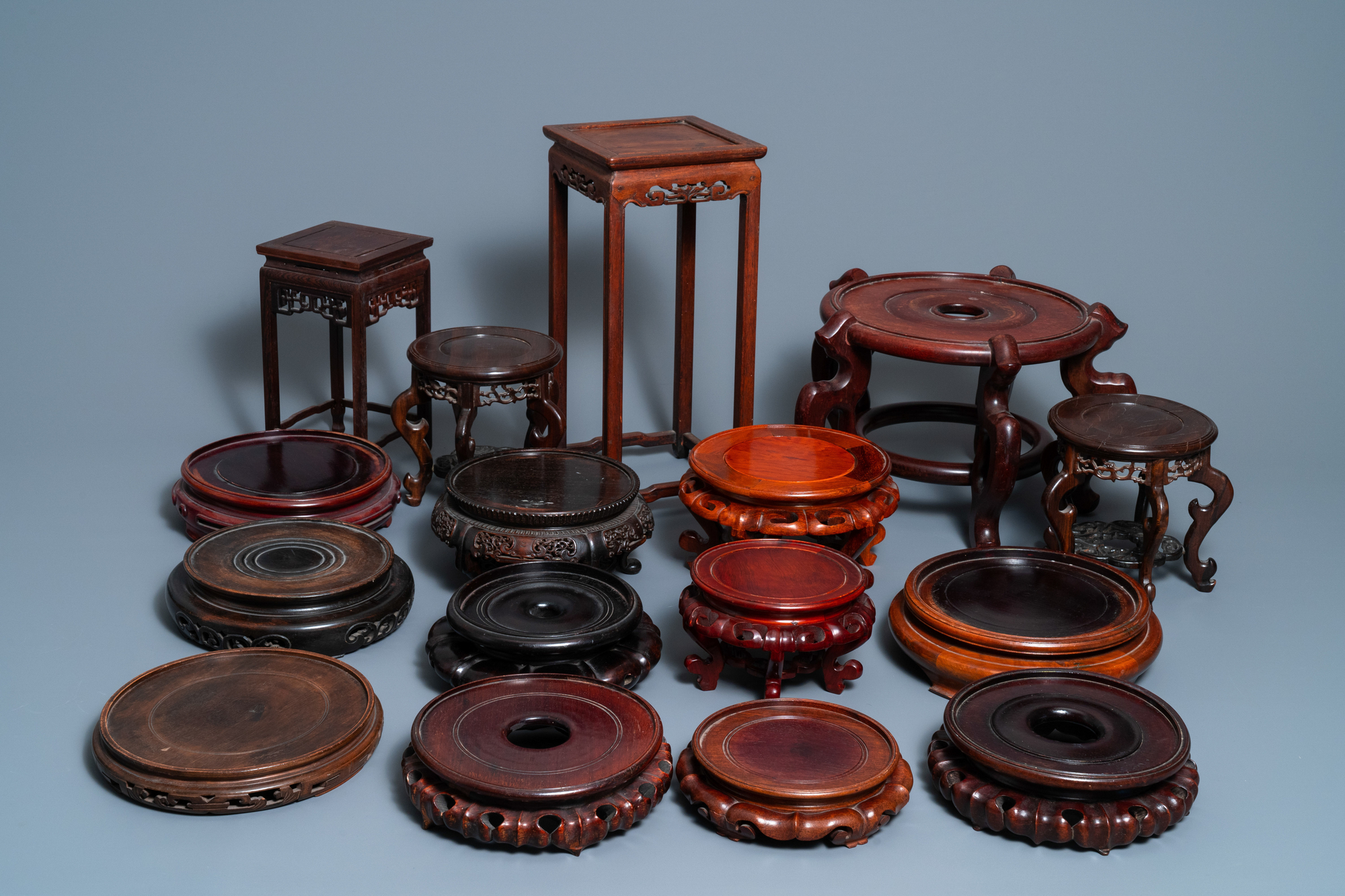 64 Chinese carved wooden stands, 19/20th C. - Image 2 of 4