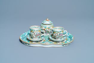 A Chinese famille rose 'tete-a-tete' tea service on tray, 19th C.
