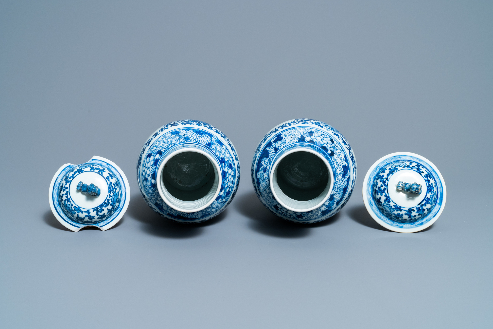 A pair of Chinese blue and white vases and a famille rose jar and cover, 19/20th C. - Image 6 of 9