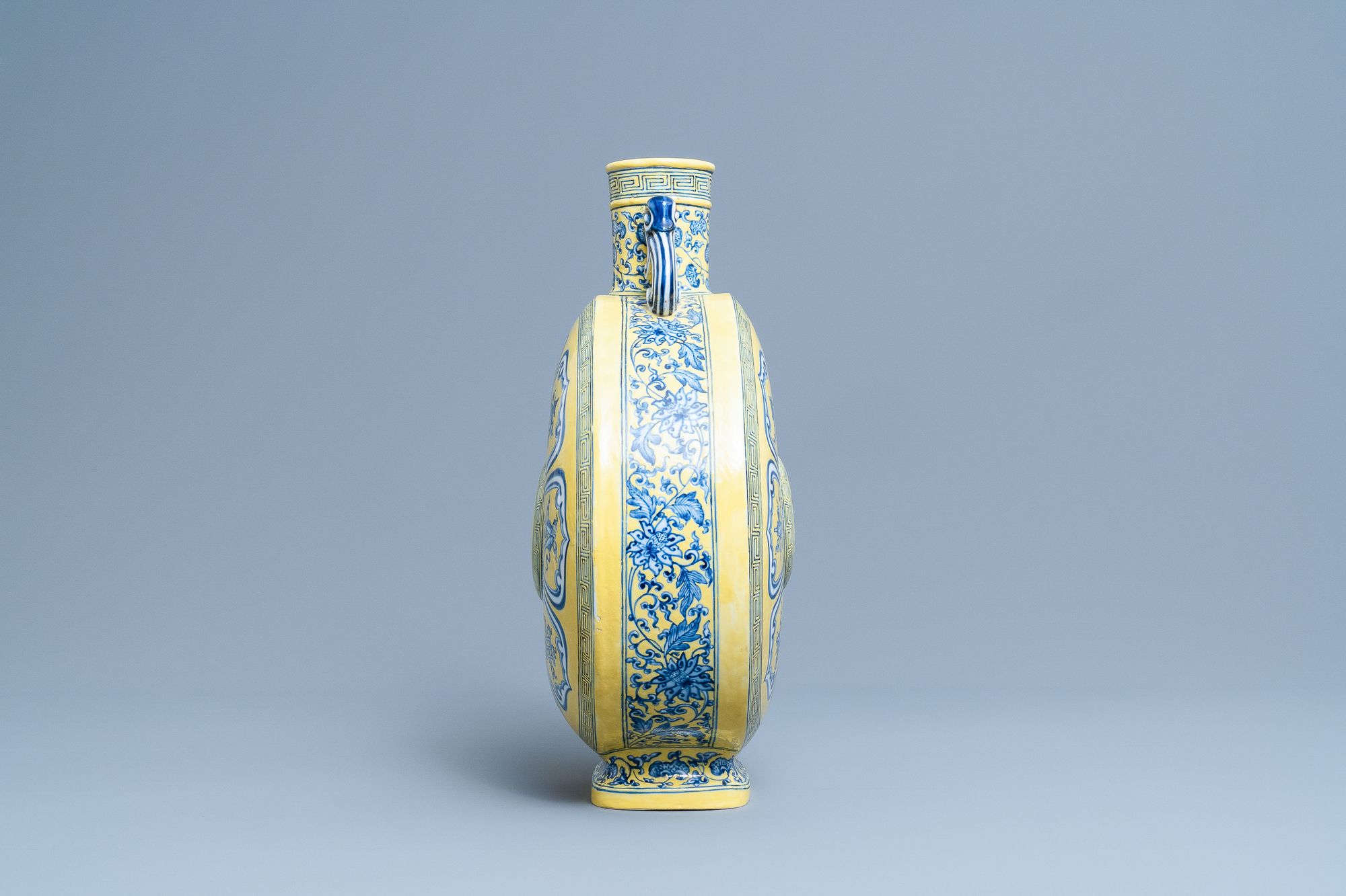 A Chinese yellow-ground blue and white 'Bajixiang' moonflask vase, Yongzheng mark, 19/20th C. - Image 2 of 20