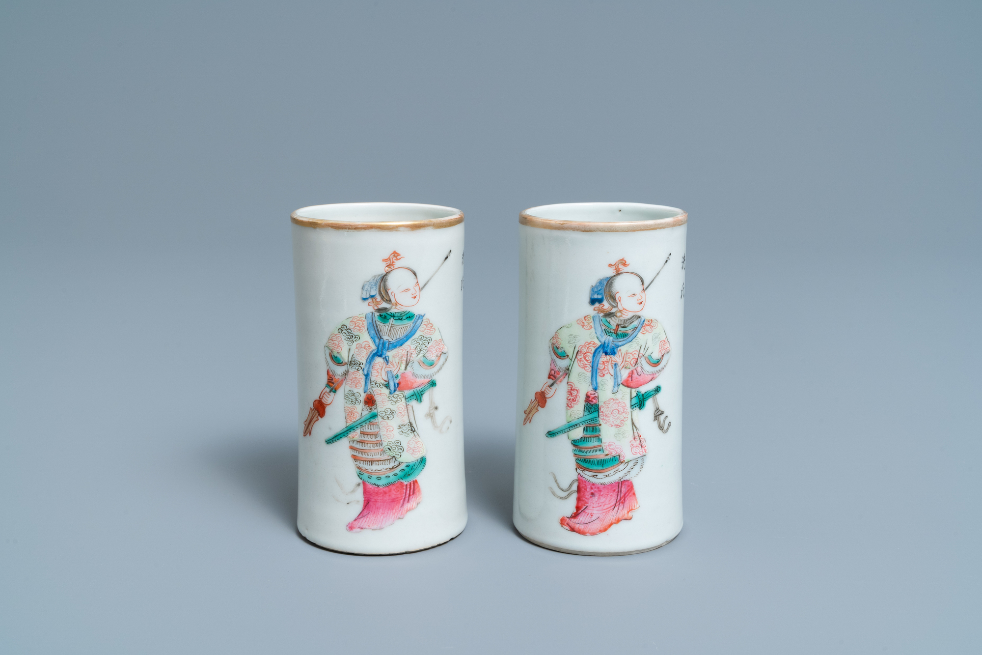 A pair of Chinese famille rose 'Wu Shuang Pu' brush pots, Daoguang mark and of the period