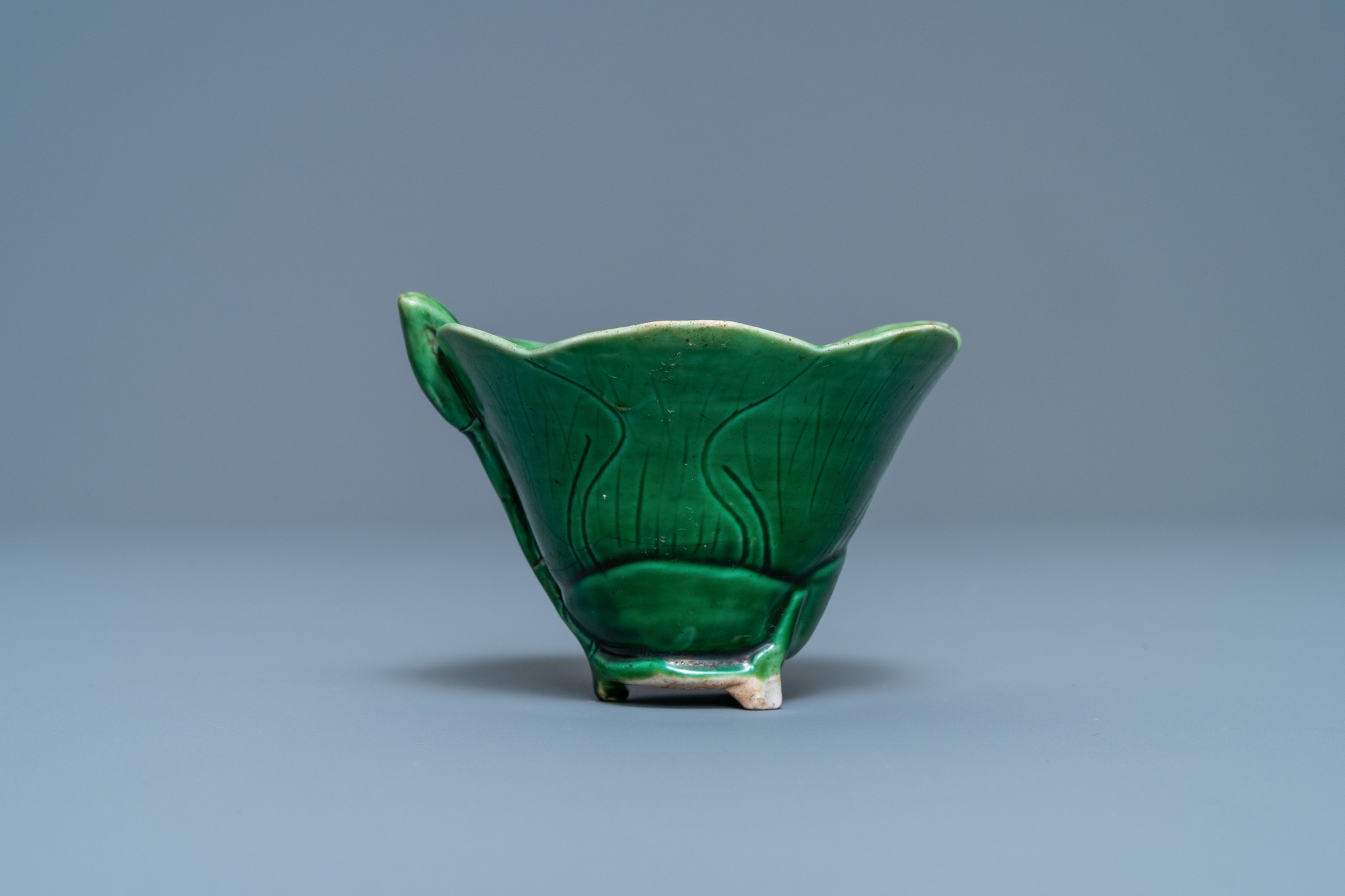 A Chinese 'egg and spinach'-glazed lotus cup and saucer with applied design, Kangxi - Image 4 of 9