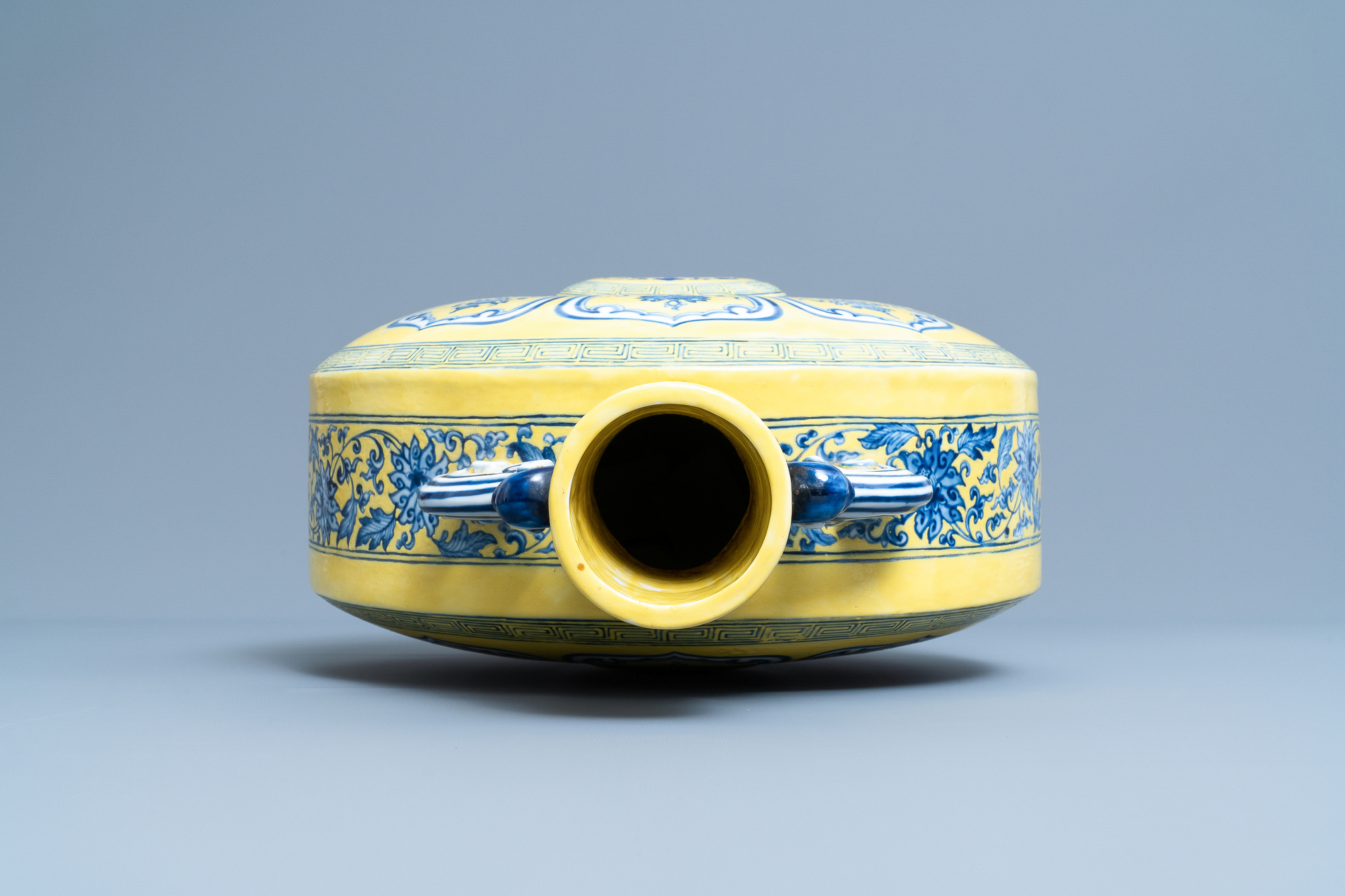 A Chinese yellow-ground blue and white 'Bajixiang' moonflask vase, Yongzheng mark, 19/20th C. - Image 5 of 20