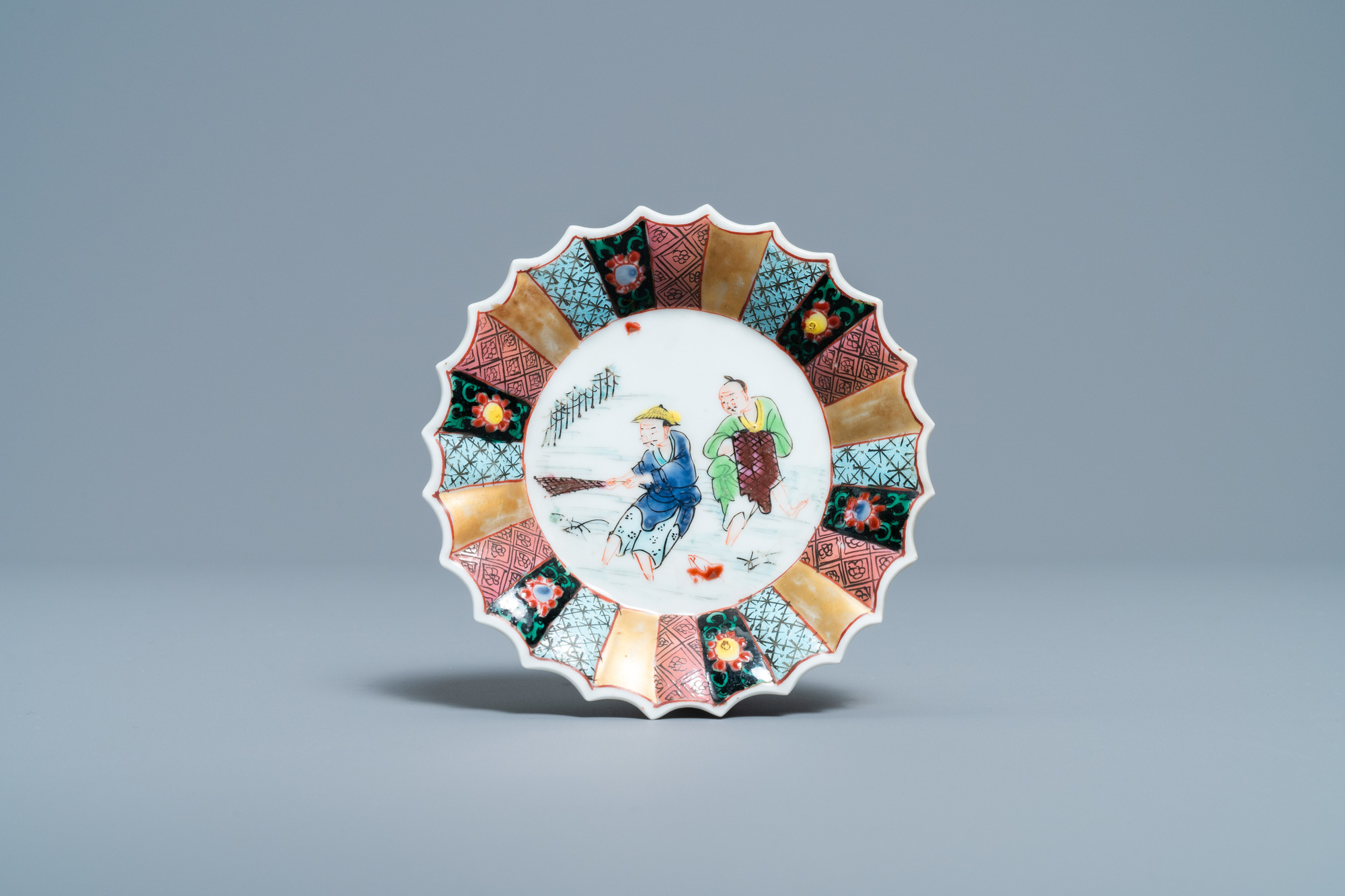 A lobed Chinese famille rose 'fishermen' cup and saucer, Yongzheng - Image 2 of 9