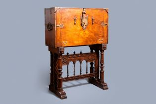 A Spanish bronze-mounted oak 'bargue–o' or cabinet on stand, 16th C.
