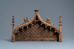 An arch-shaped carved oak baldachin or throne top, France, 15th C.