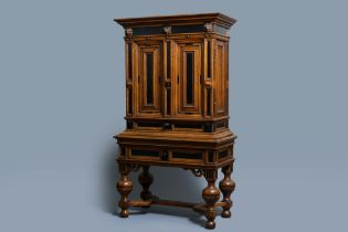 An oak and ebony two-door cabinet, The Low Countries, 17th C.