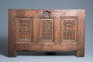 A carved oak front panel of a coffer with the arms of France and the Dauphin, France, 2nd half 15th