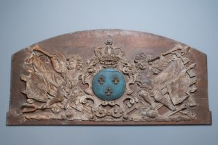 A large polychromed carved oak panel with putti and trophies flanking the royal coat of arms of Fran